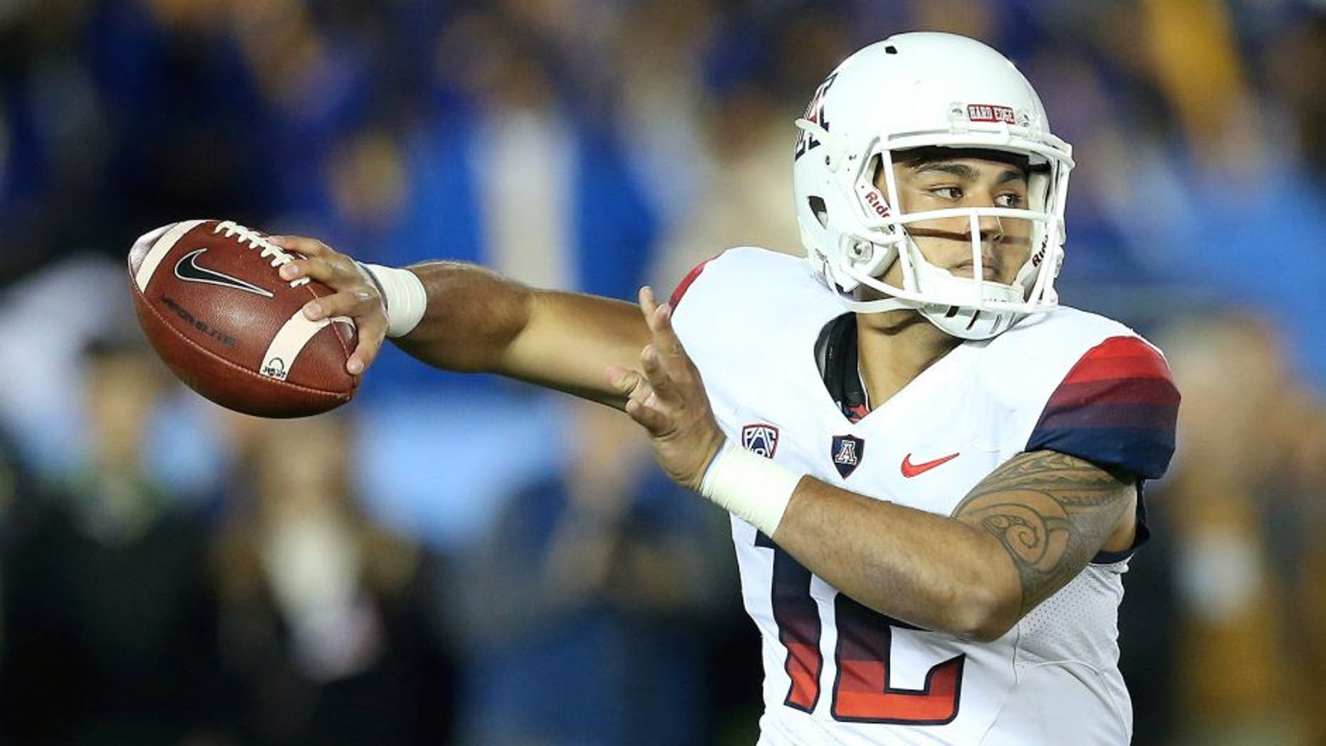 PASADENA, CA - NOVEMBER 01: Quarterback Anu Solomon #12 of the Arizona Wildcats rolls out to throw a pass against the UCLA Bruins at the Rose Bowl on November 1, 2014 in Pasadena, California. (Photo by Stephen Dunn/Getty Images)