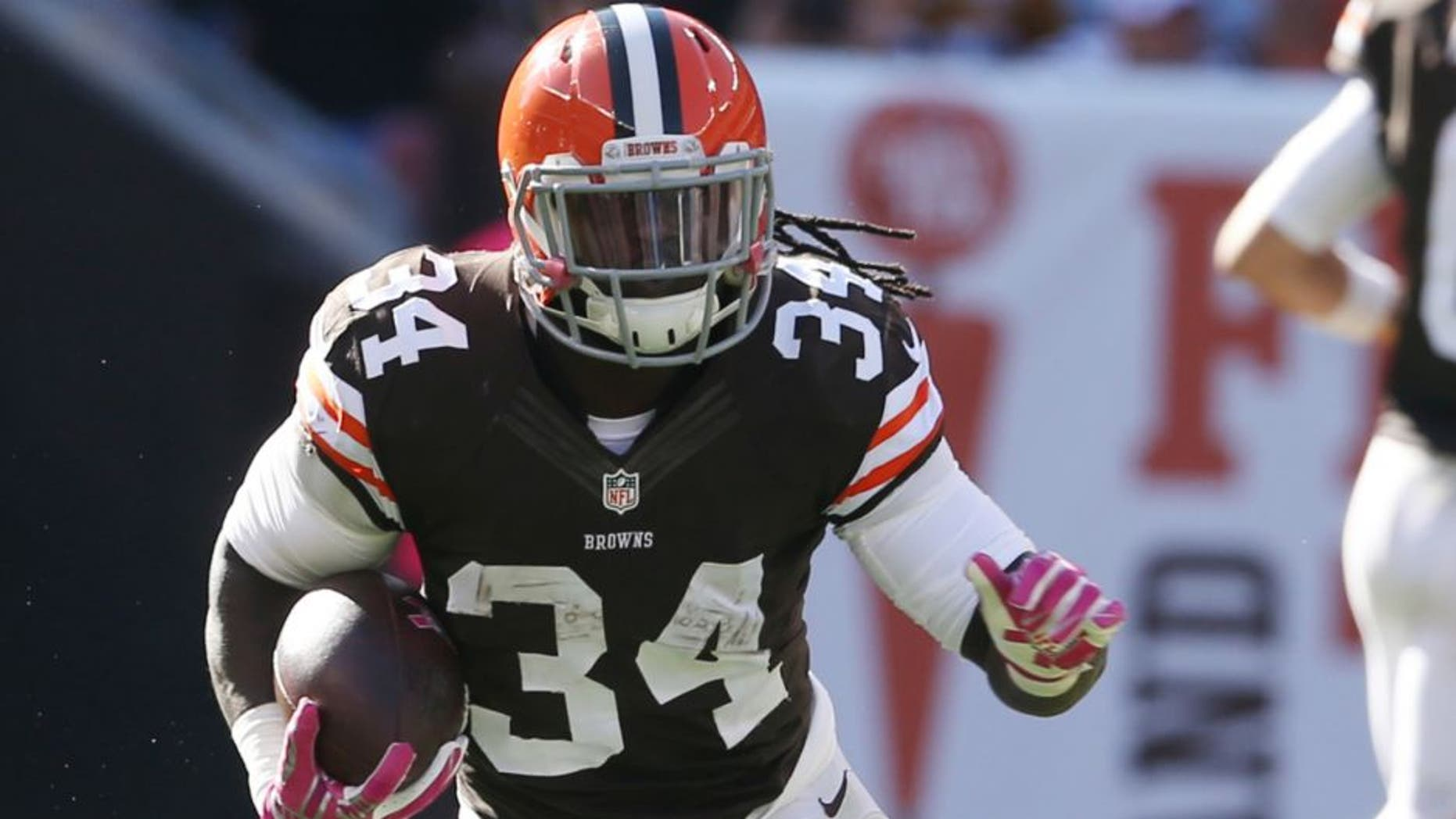 Oct 12, 2014; Cleveland, OH, USA; Cleveland Browns running back Isaiah Crowell (34) against the Pittsburgh Steelers during the fourth quarter at FirstEnergy Stadium. The Browns won 31-10. Mandatory Credit: Ron Schwane-USA TODAY Sports