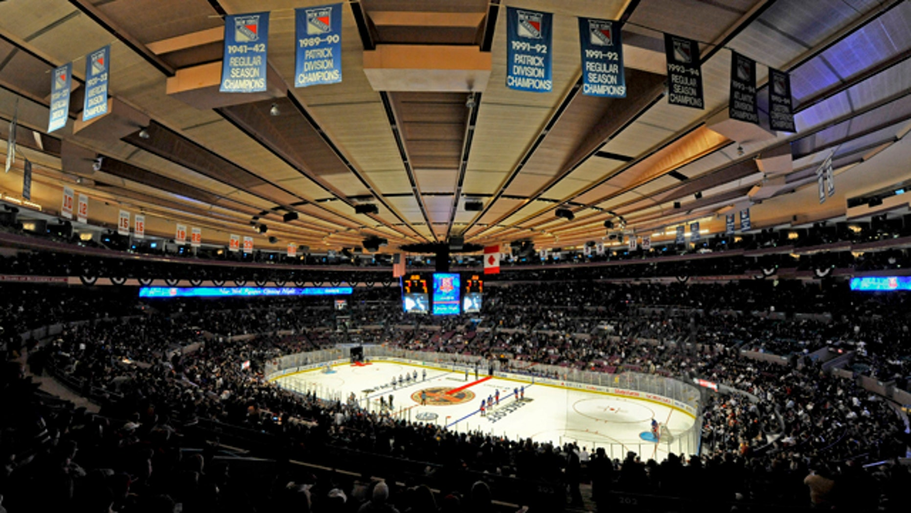 Oct. 15: The New York Rangers and the Toronto Maple Leafs line up for the singing of the each team's national anthems during opening night of the Rangers' NHL hockey season at Madison Square Garden in New York.