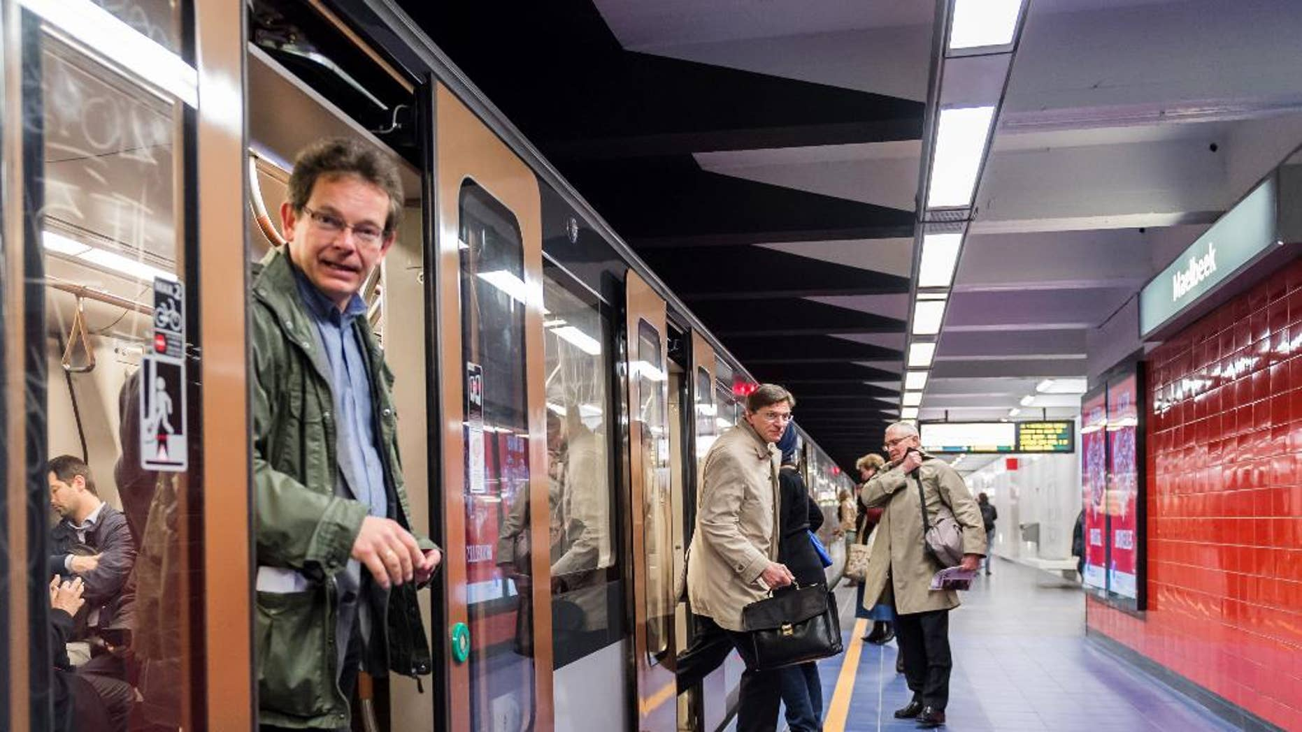Commuters arrive at Maelbeek metro station in Brussels on Monday April 25, 2016. For the first time since the March 22 attacks, all of the Brussels metro lines are operating a full schedule again. The Maelbeek station reopened after being closed more than a month due to the terrorist bombing that killed 16 people and wounded many more.  (AP Photo/Geert Vanden Wijngaert)