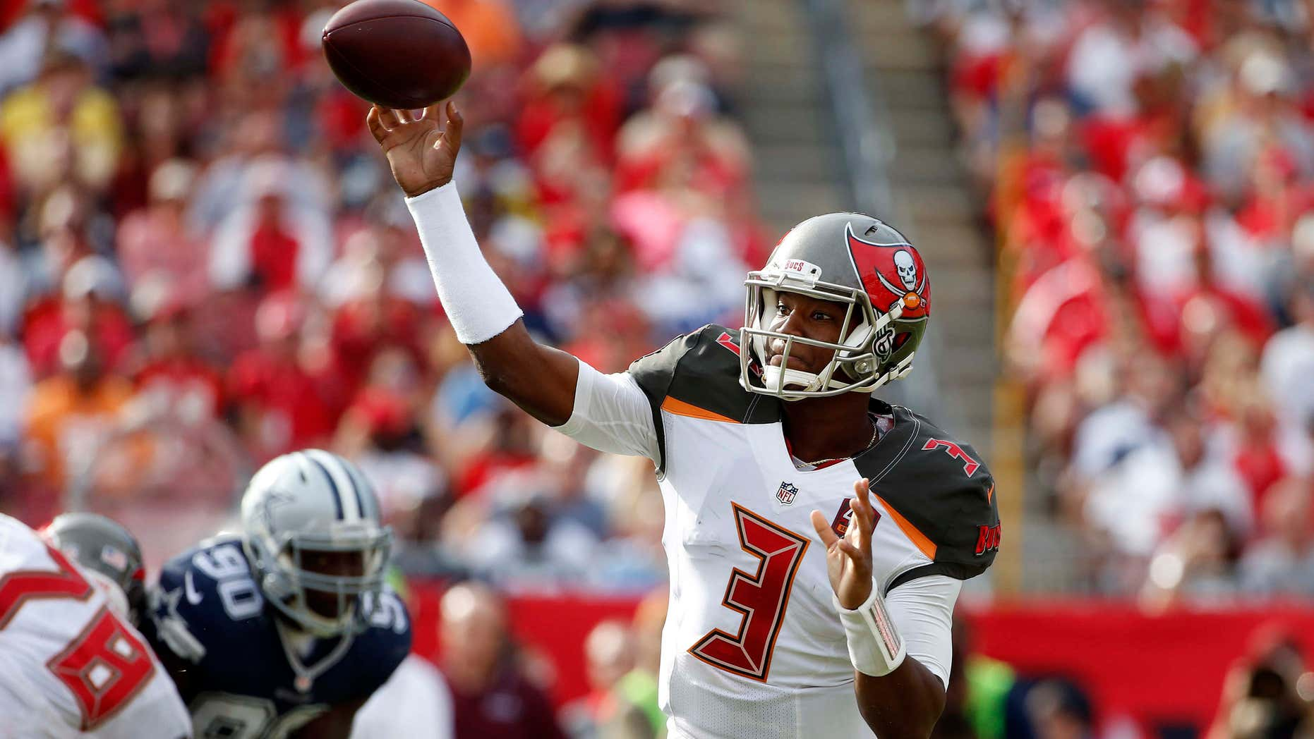 FILE - In this Nov. 15, 2015, file photo, Tampa Bay Buccaneers quarterback Jameis Winston (3) throws a pass against the Dallas Cowboys during the second quarter of an NFL football game, in Tampa, Fla.