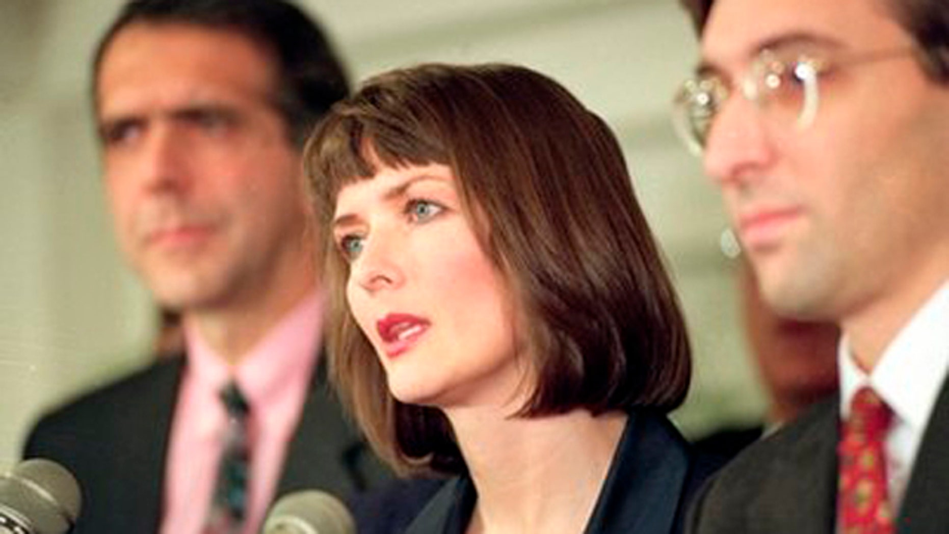 In this Dec. 10, 1992 file photo, flanked by her attorneys Frank Morocco, left, and Sheldon T. Zenner, right, Lawrencia Bembenek answers questions at a new conference in Chicago, Ill.