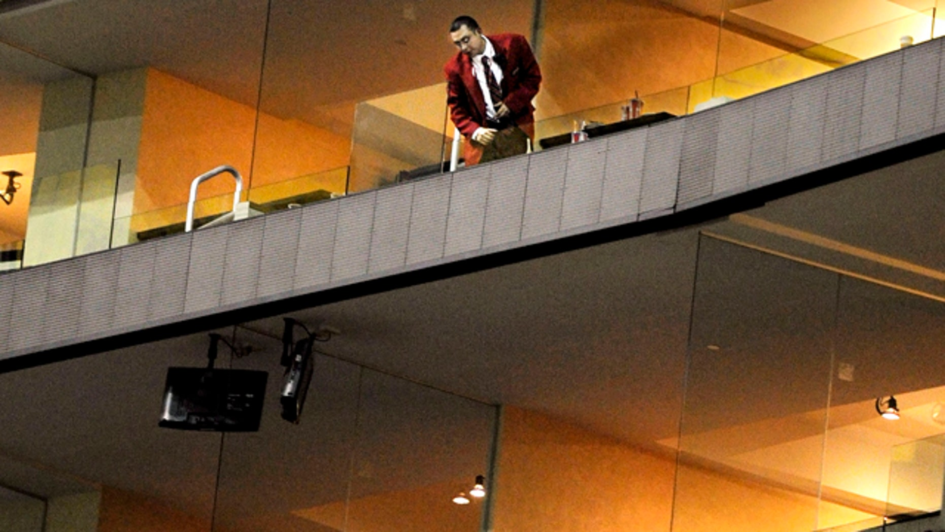 Nov. 21: A security guard, top, looks down from where a young boy fell to where a second security guard stands following the Los Angeles Lakers' NBA basketball game against the Golden State Warriors at Staples Center in Los Angeles.
