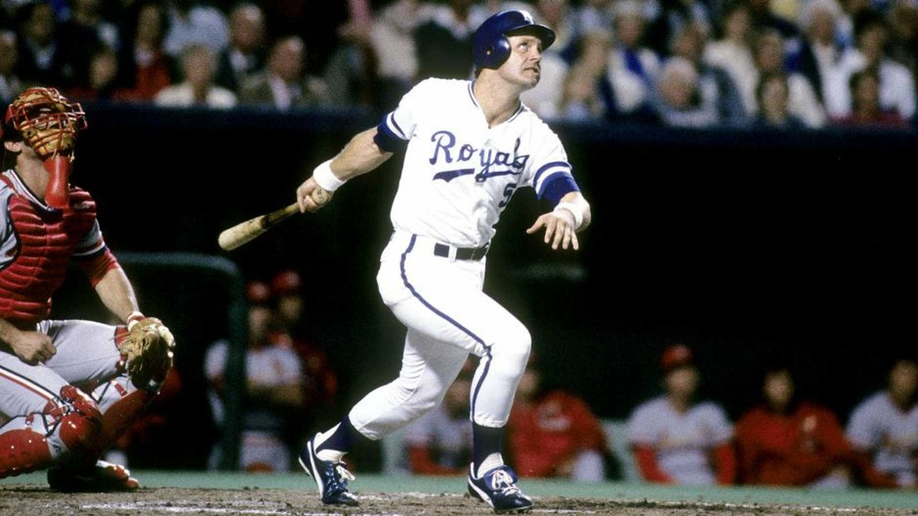 KANSAS CIT, MO - OCTOBER, 1985: Third baseman George Brett #5 swings and watches the flight of his ball against the St. Louis Cardinals in the World Series, October, 1985 at Royals Stadium in Kansas City, Missouri. The Royals won the series 4 games to 3. Brett played for the Royals from 1973-93. (Photo by Focus on Sport/Getty Images)
