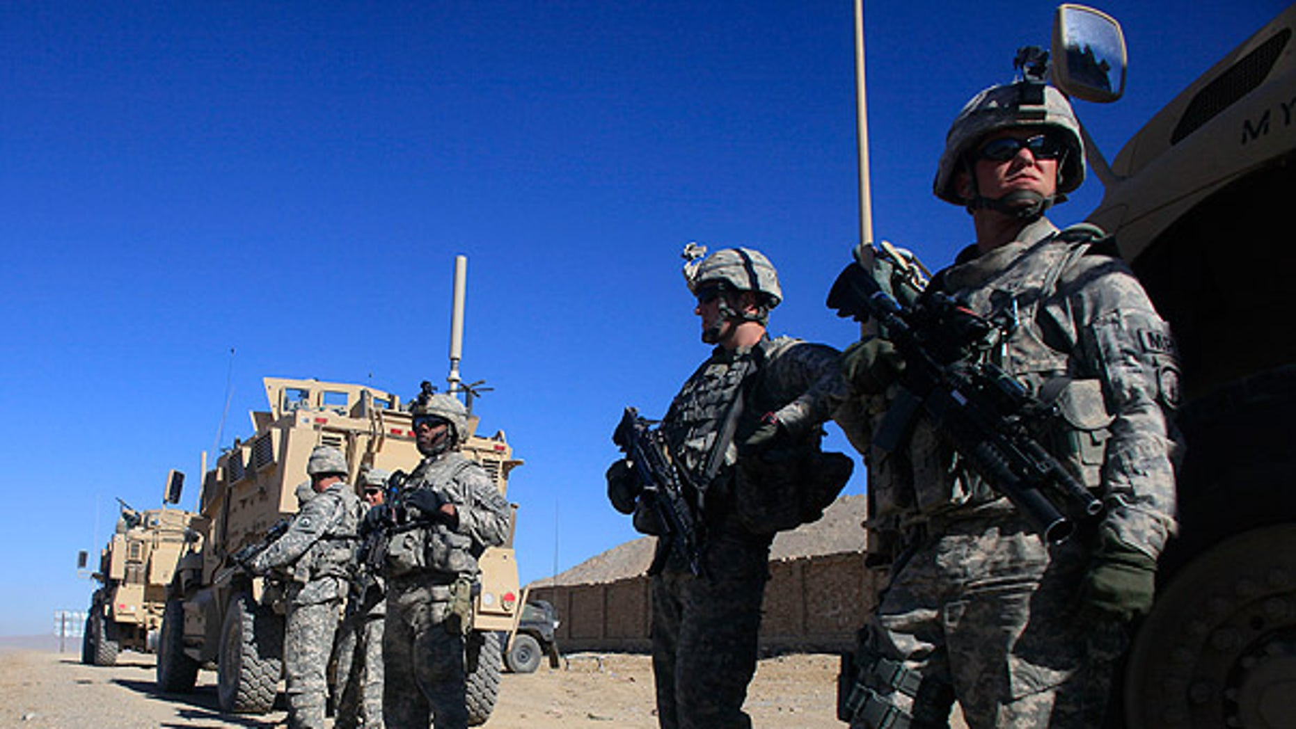 Nov. 19: U.S. Army soldiers stand next to their vehicles at a checkpoint near the town of Balisal Afghan, Afghanistan. (AP)
