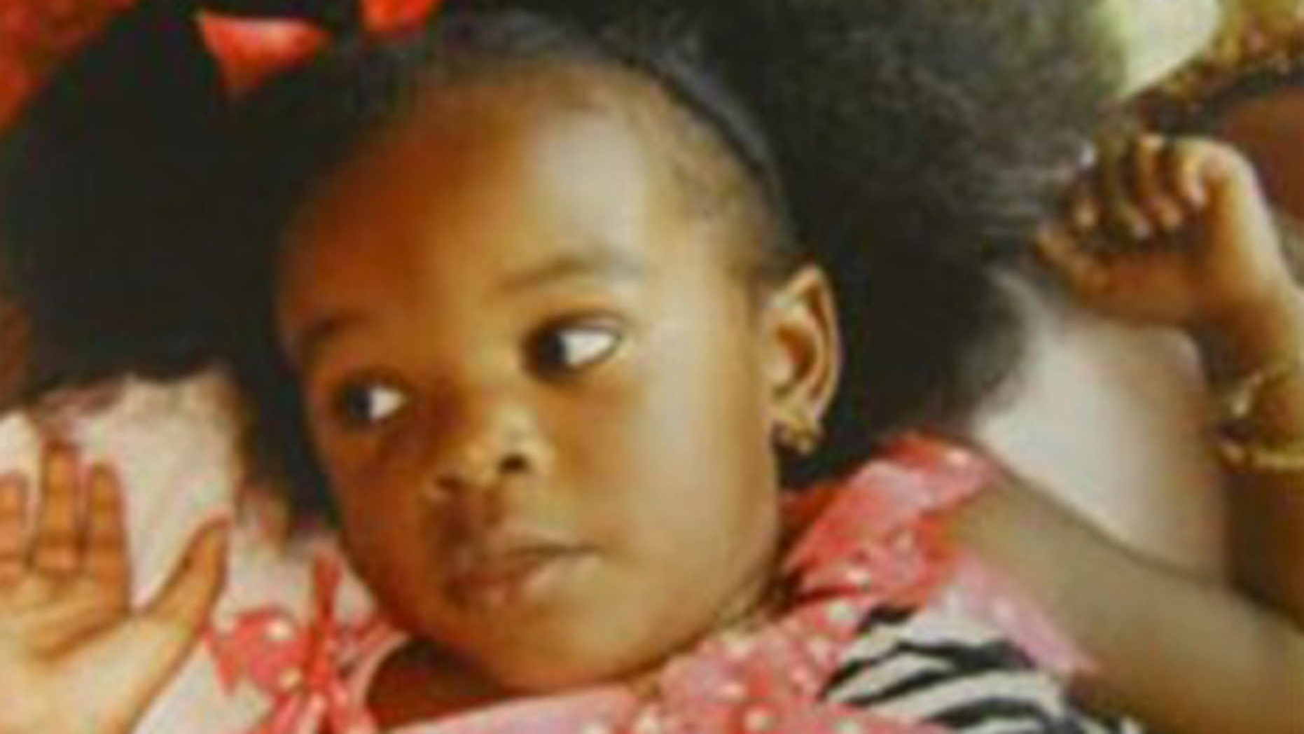 November 23, 2011: This photo provided by the Ocean County Prosecutor's Office shows Tierra Morgan of Lakehurst NJ, who was found dead in her car seat, partially submerged in a stream in Monmouth County's  Shark River Park.