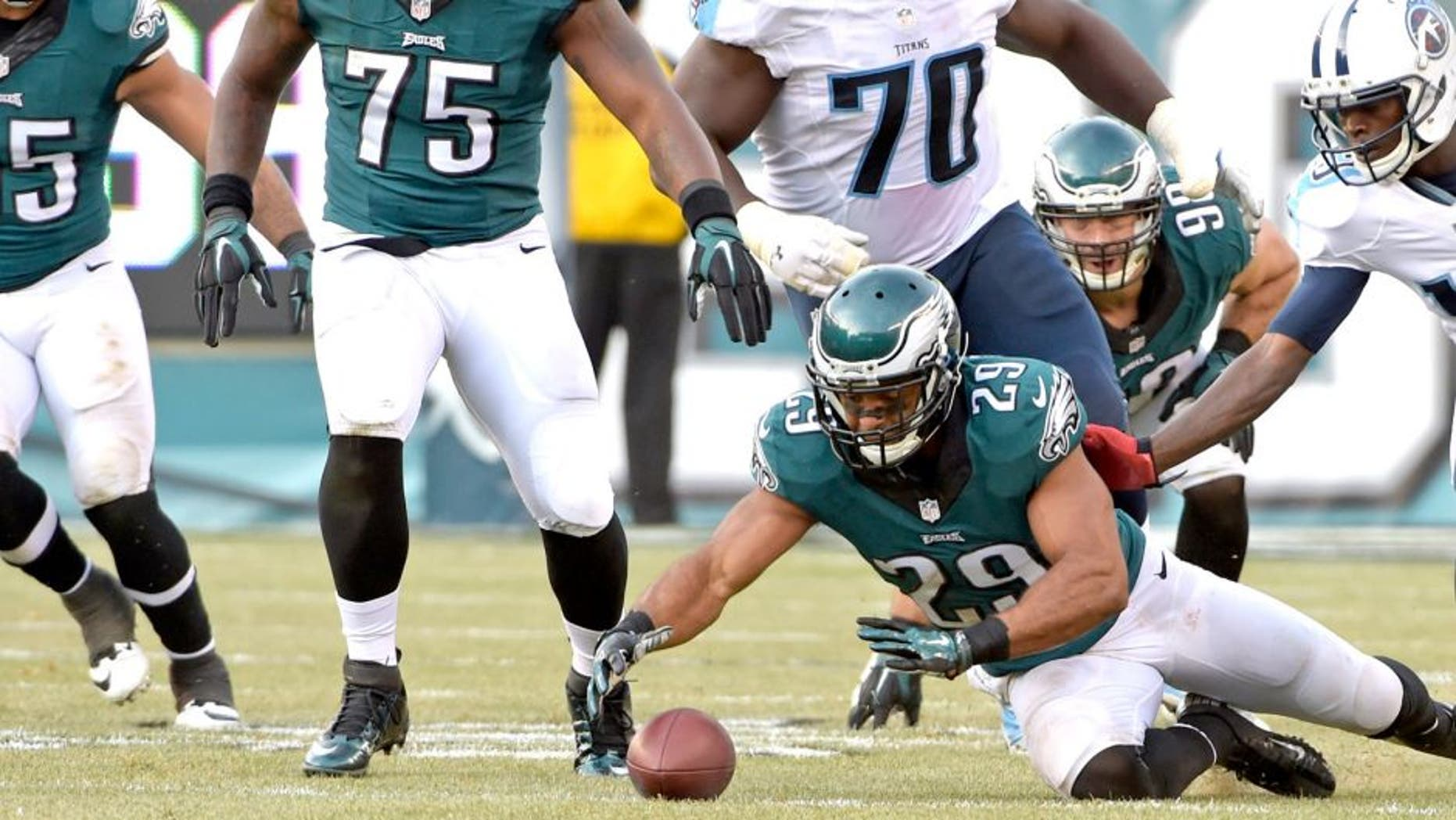 Nov 23, 2014; Philadelphia, PA, USA; Philadelphia Eagles strong safety Nate Allen (29) recovers a fumble during third quarter against the Tennessee Titans at Lincoln Financial Field. The Eagles defeated the Titans, 43-24. Mandatory Credit: Eric Hartline-USA TODAY Sports