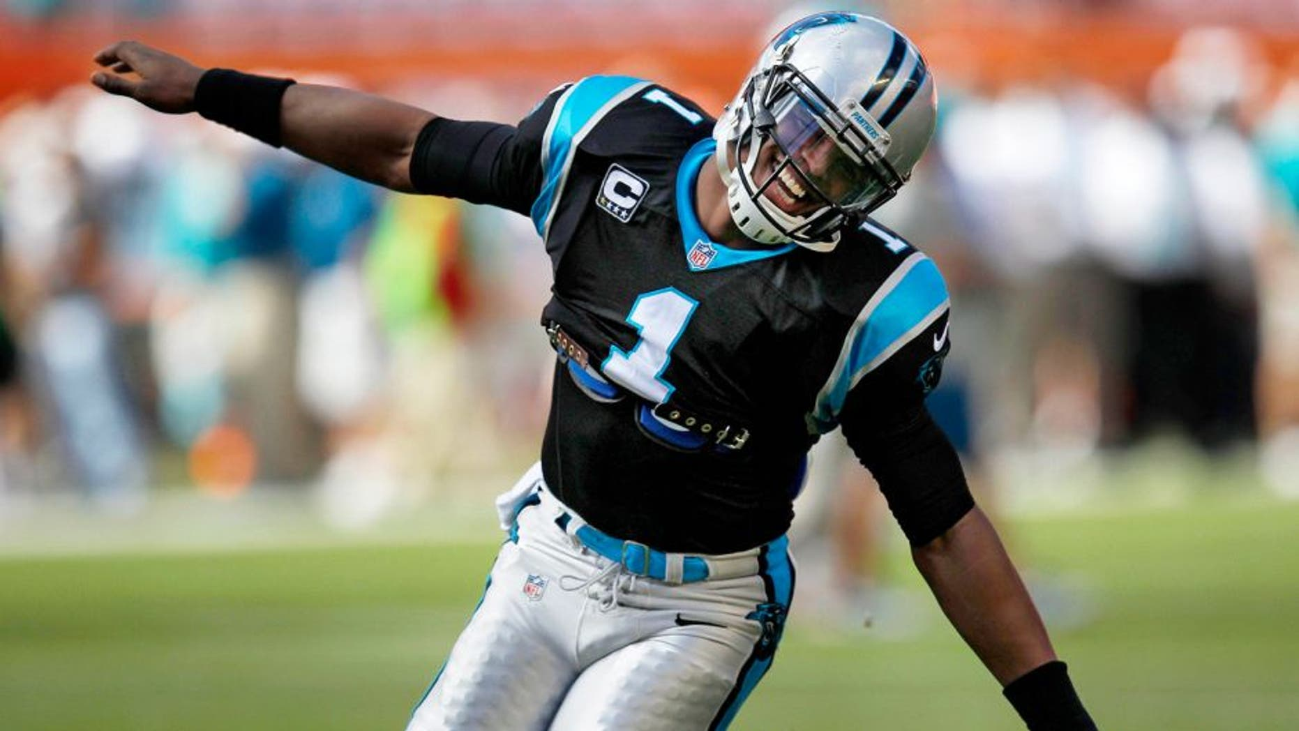 Nov 24, 2013; Miami Gardens, FL, USA; Carolina Panthers quarterback Cam Newton (1) before playing against the Miami Dolphins at Sun Life Stadium. Mandatory Credit: Robert Mayer-USA TODAY Sports