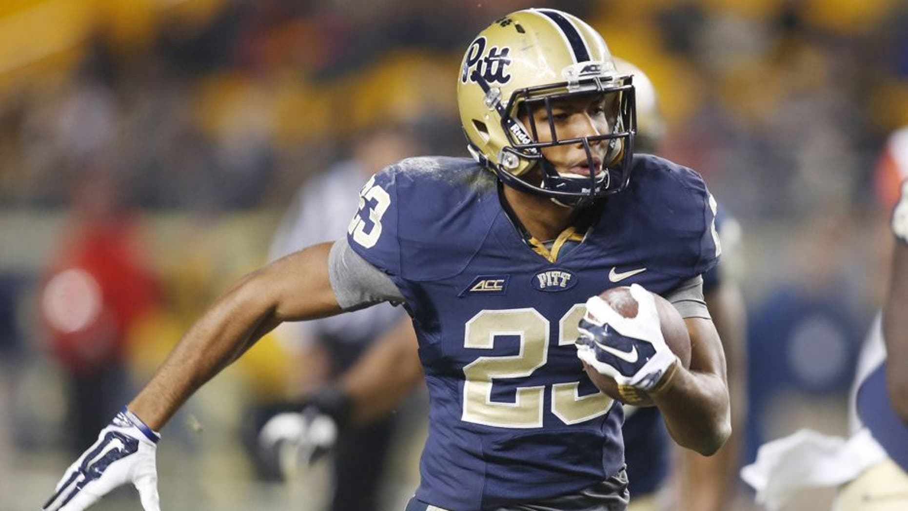 Nov 22, 2014; Pittsburgh, PA, USA; Pittsburgh Panthers wide receiver Tyler Boyd (23) runs on a forty-nine yard touchdown reception against the Syracuse Orange during the fourth quarter at Heinz Field. Pittsburgh won 30-7. Mandatory Credit: Charles LeClaire-USA TODAY Sports