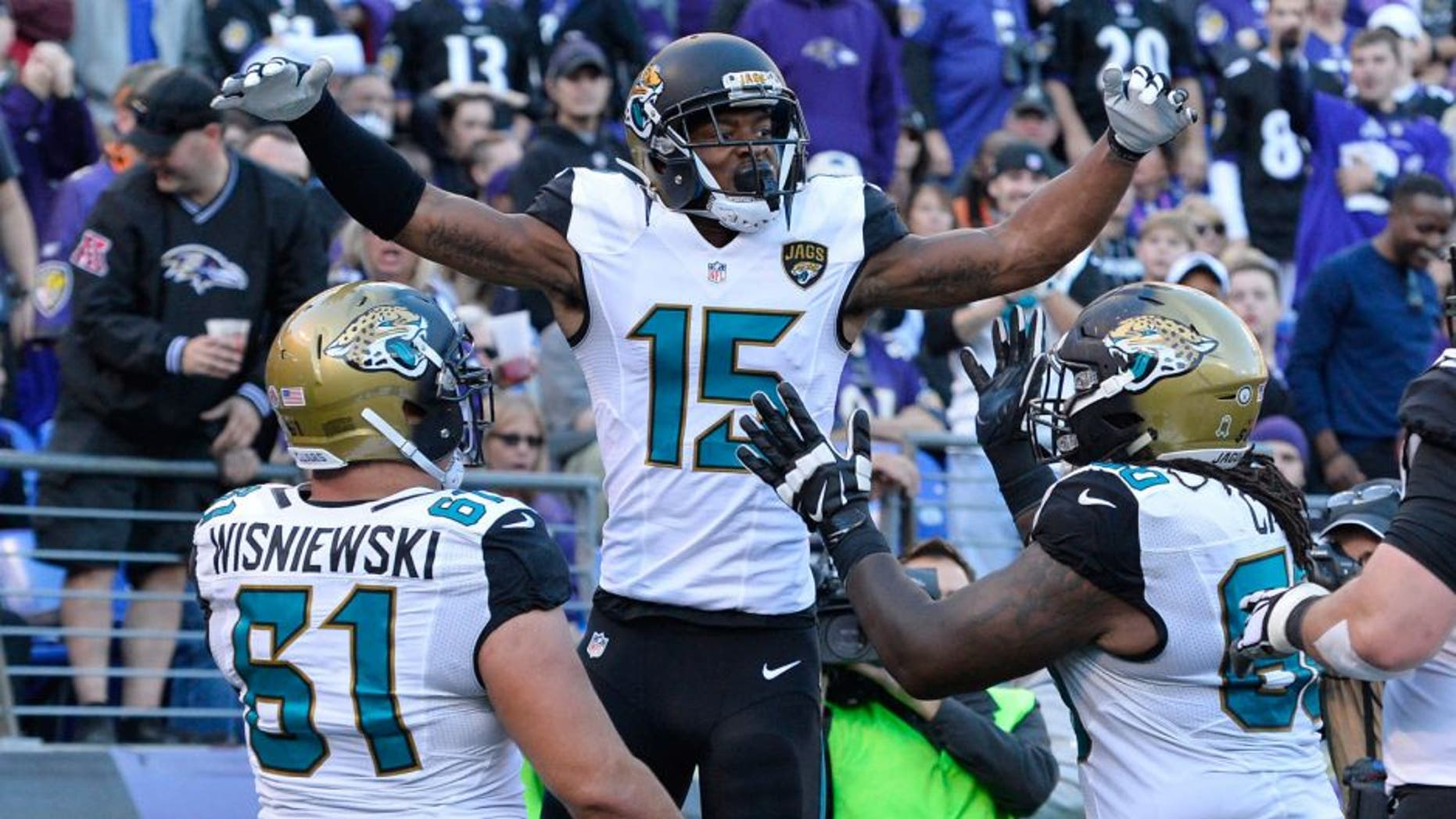 Nov 15, 2015; Baltimore, MD, USA; Jacksonville Jaguars wide receiver Allen Robinson (15) celebrates with teammates after catching a touchdown pass during the fourth quarter against the Baltimore Ravens at M&T Bank Stadium. Mandatory Credit: Tommy Gilligan-USA TODAY Sports