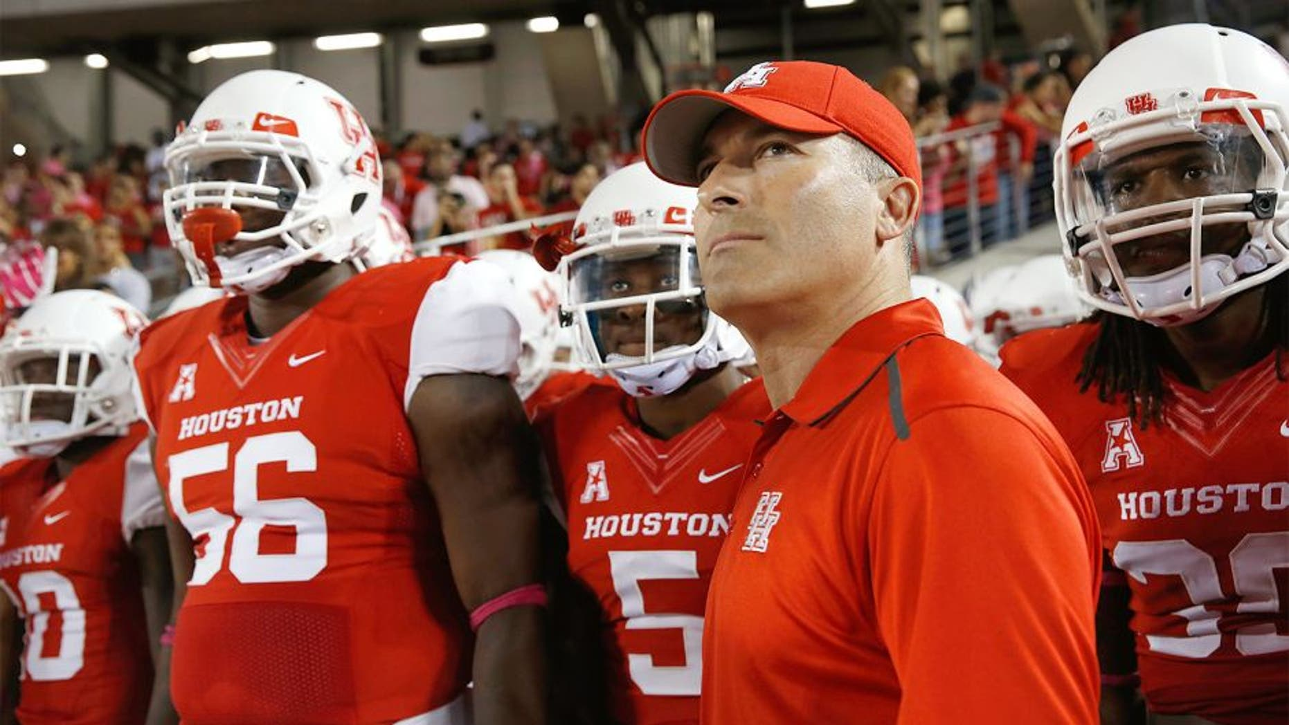 HOUSTON, TX - OCTOBER 17: Head coach of the Houston Cougars Tony Levine waits with his team prior to the start of their game against the Temple Owls at TDECU Stadium on October 17, 2014 in Houston, Texas. (Photo by Scott Halleran/Getty Images)