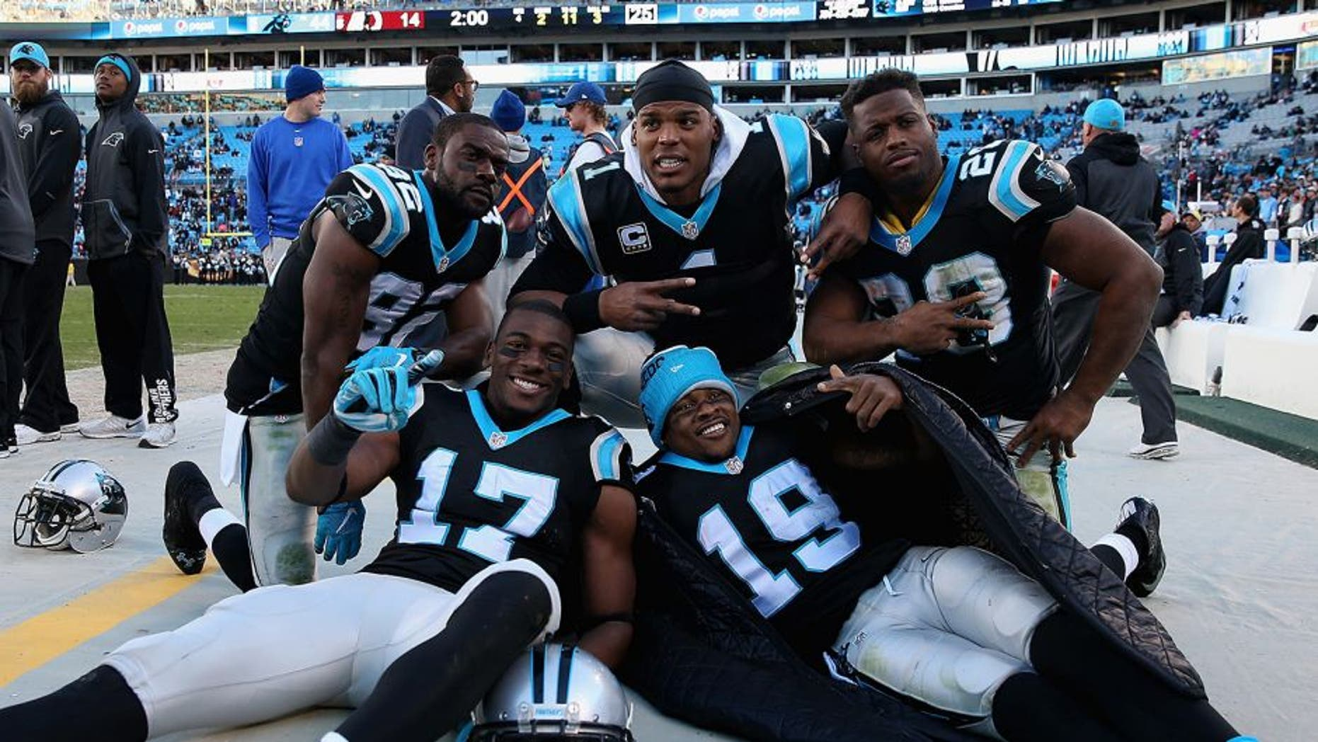 CHARLOTTE, NC - NOVEMBER 22: Teammates Jerricho Cotchery #82, Devin Funchess #17, Ted Ginn #19, Jonathan Stewart #28 and Cam Newton #1 of the Carolina Panthers celebrate after defeating the Washington Redskins 44-16 at Bank of America Stadium on November 22, 2015 in Charlotte, North Carolina. (Photo by Streeter Lecka/Getty Images)
