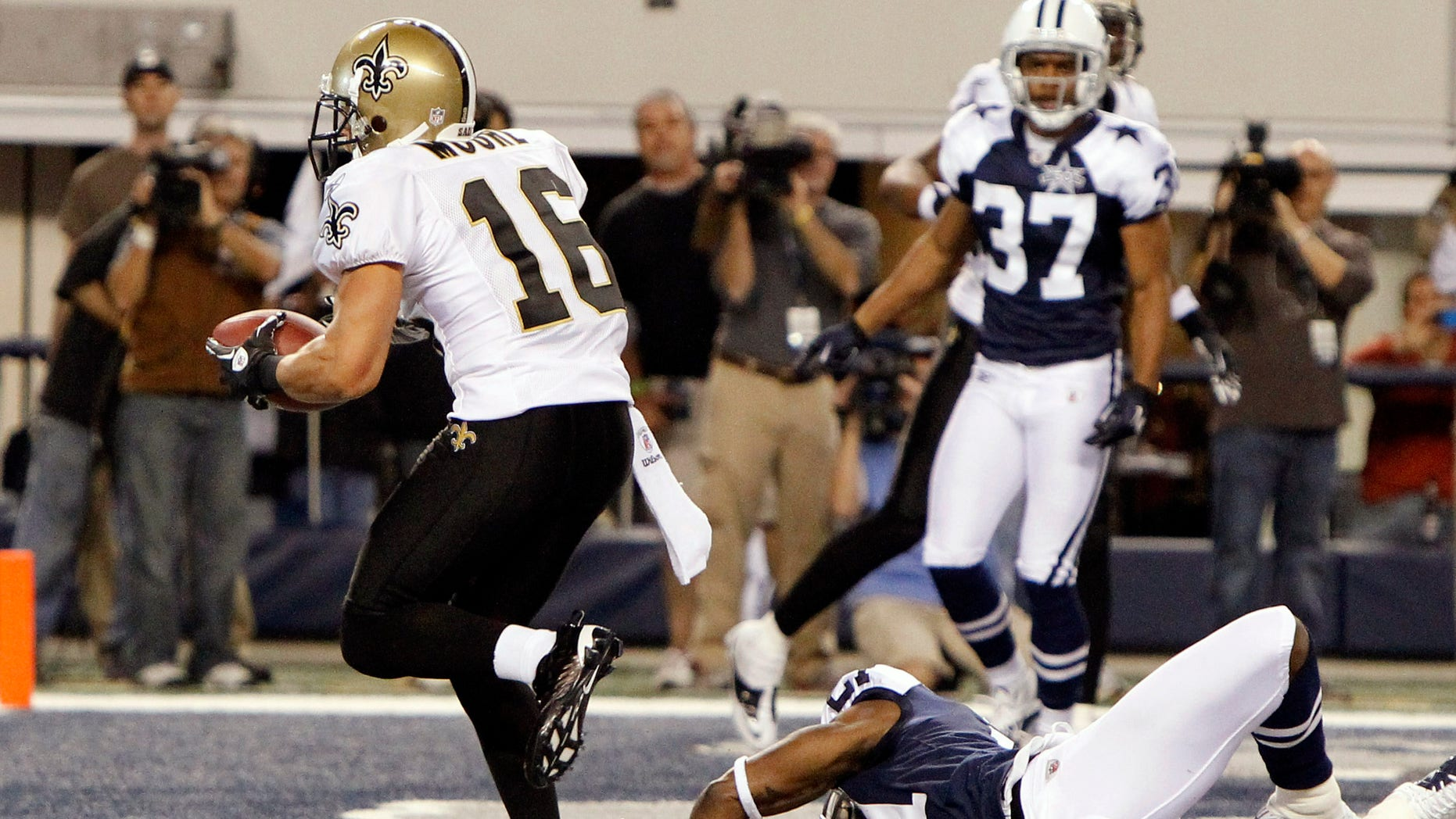 Nov. 25: New Orleans Saints wide receiver Lance Moore (16) scores the game-winning touchdown against Dallas Cowboys cornerback Mike Jenkins (21) as Bryan McCann (37) looks on during the fourth-quarter of the NFL football game in Arlington, Texas.