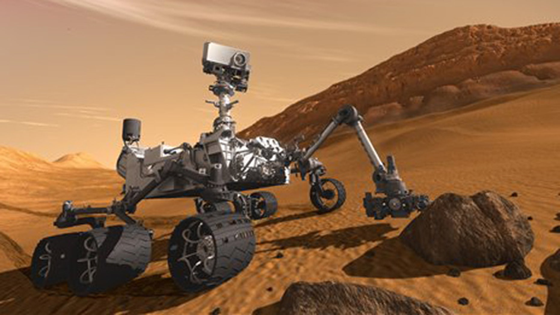 In this 2011 artist's rendering provided by NASA/JPL-Caltech, the Mars Science Laboratory Curiosity rover examines a rock on Mars with a set of tools at the end of its arm, which extends about 7 feet.