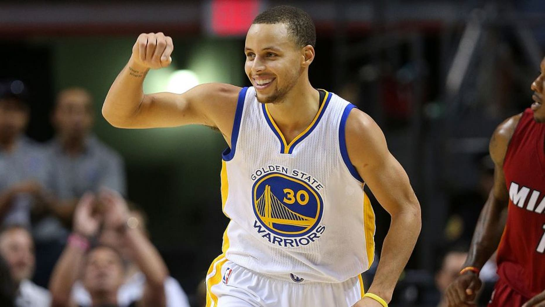 MIAMI, FL - NOVEMBER 25: Stephen Curry #30 of the Golden State Warriors reacts to a play during a game against the Miami Heat at American Airlines Arena on November 25, 2014 in Miami, Florida. NOTE TO USER: User expressly acknowledges and agrees that, by downloading and/or using this photograph, user is consenting to the terms and conditions of the Getty Images License Agreement. Mandatory copyright notice: (Photo by Mike Ehrmann/Getty Images)