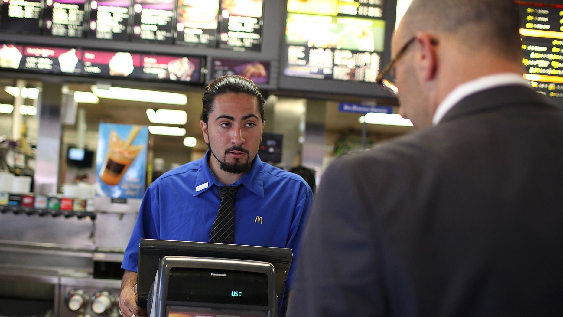 SAN FRANCISCO, CA - APRIL 19:  McDonald's employee Salvador Ibarra takes an order during a one-day hiring event at a McDonald's restaurant on April 19, 2011 in San Francisco, California.  Hundreds of job seekers filled out applications and were interviewed at a San Francisco McDonald's restaurant during a one-day nationwide event at the chain as they look to fill 50,000 positions at stores nationwide.  (Photo by Justin Sullivan/Getty Images)