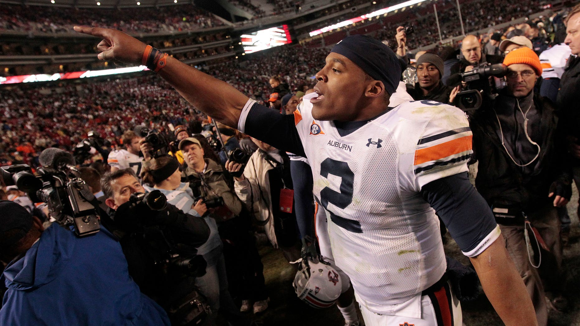 Nov. 26: Auburn quarterback Cameron Newton celebrates after their 28-27 win over Alabama in an NCAA college football game at Bryant-Denny Stadium in Tuscaloosa, Ala.