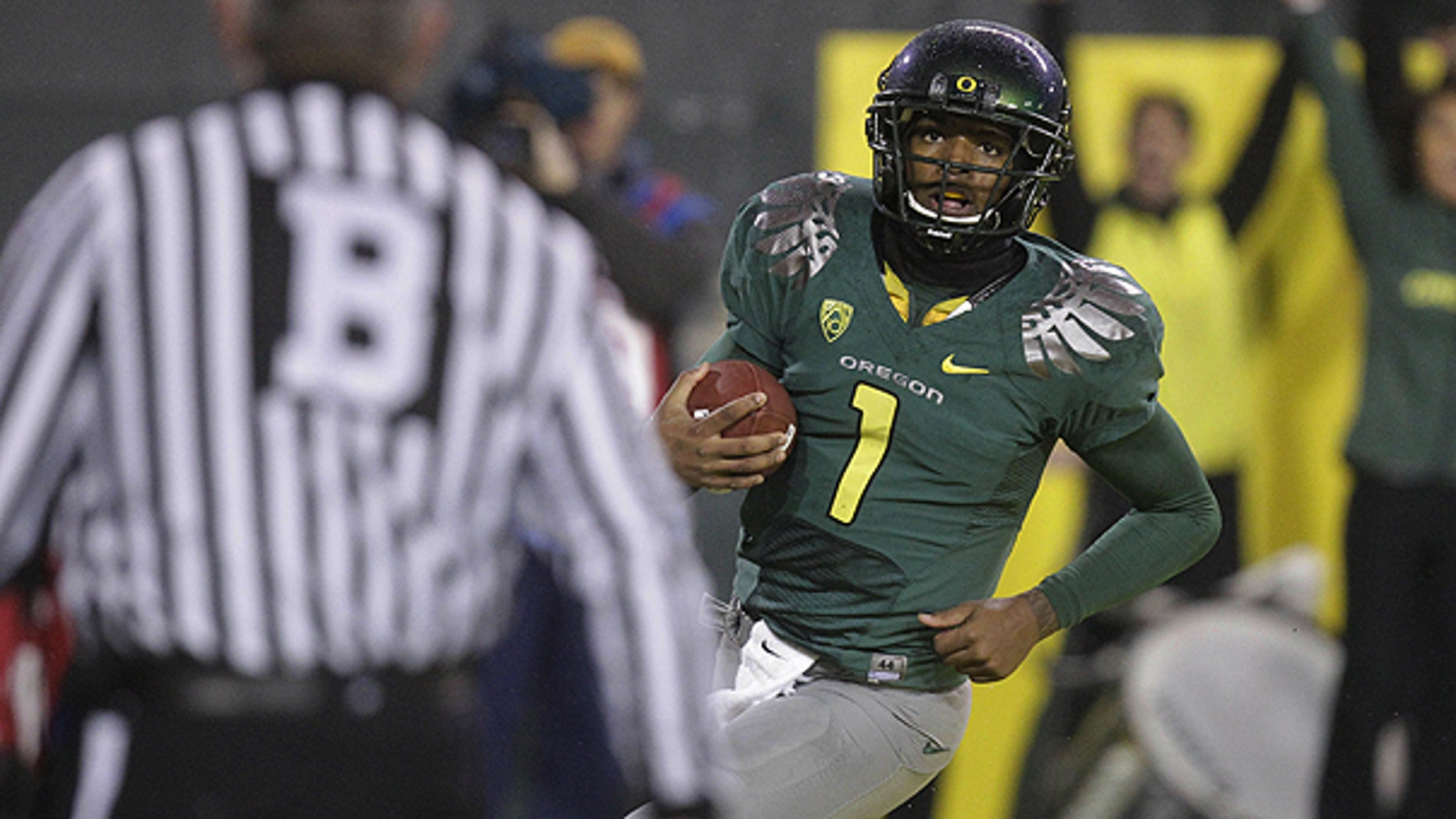 nov. 26: Oregon quarterback Darron Thomas (1) looks up after scoring a touch down in the third quarter during an NCAA college football game against Arizona in Eugene, Ore.