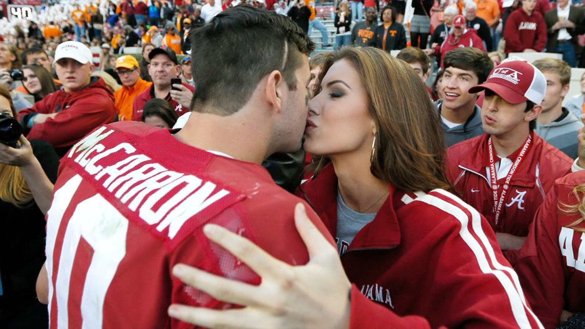 TUSCALOOSA, AL - OCTOBER 26: AJ McCarron #10 of the Alabama Crimson Tide kisses girlfriend Katherine Webb after their 45-10 win over the Tennessee Volunteers at Bryant-Denny Stadium on October 26, 2013 in Tuscaloosa, Alabama. (Photo by Kevin C. Cox/Getty Images)