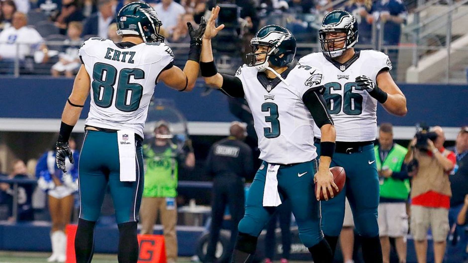 ARLINGTON, TX - NOVEMBER 27: Mark Sanchez #3 of the Philadelphia Eagles is congratulated by Zach Ertz #86 of the Philadelphia Eagles as Andrew Gardner #66 of the Philadelphia Eagles is near after he scored a touchdown against the Dallas Cowboys in the first half at AT&T Stadium on November 27, 2014 in Arlington, Texas. (Photo by Tom Pennington/Getty Images)