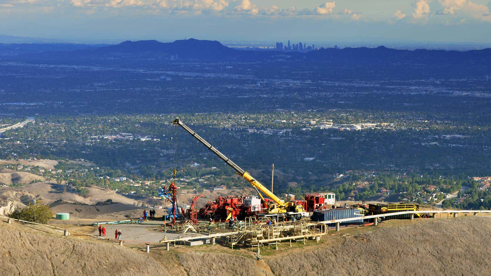 FILE - In this Nov. 3, 2015, file photo, provided by Southern California Gas Co. shows equipment being used as SoCalGas crews and technical experts try to stop the flow of natural gas leaking from a storage well at the utility's Aliso Canyon facility near the Northridge section of Los Angeles.