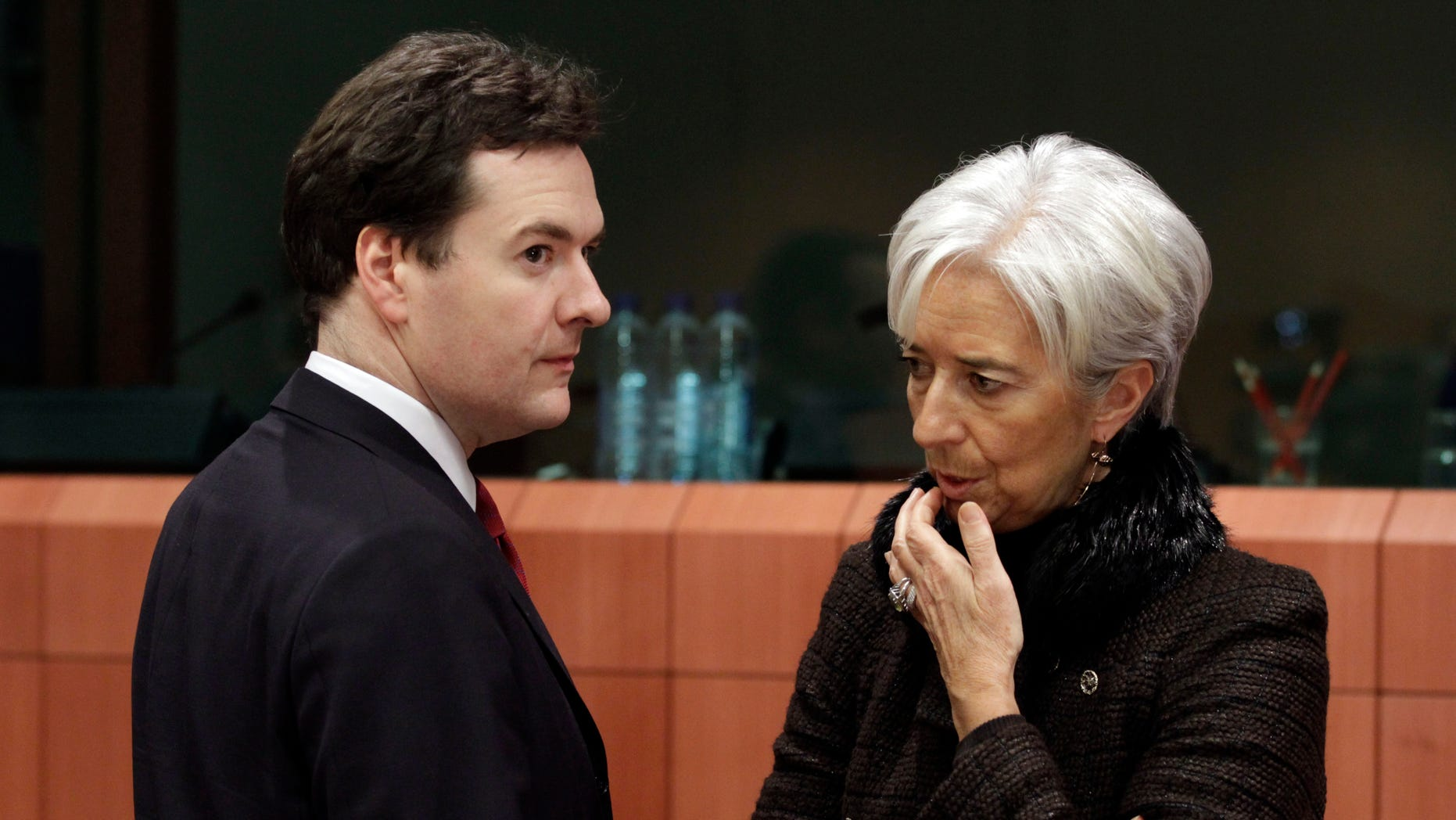 Nov. 28: French Finance Minister Christine Lagarde, right, shares a word with British Chancellor of the Exchequer George Osborne during a round table of eurozone finance ministers at the EU Council building in Brussels.