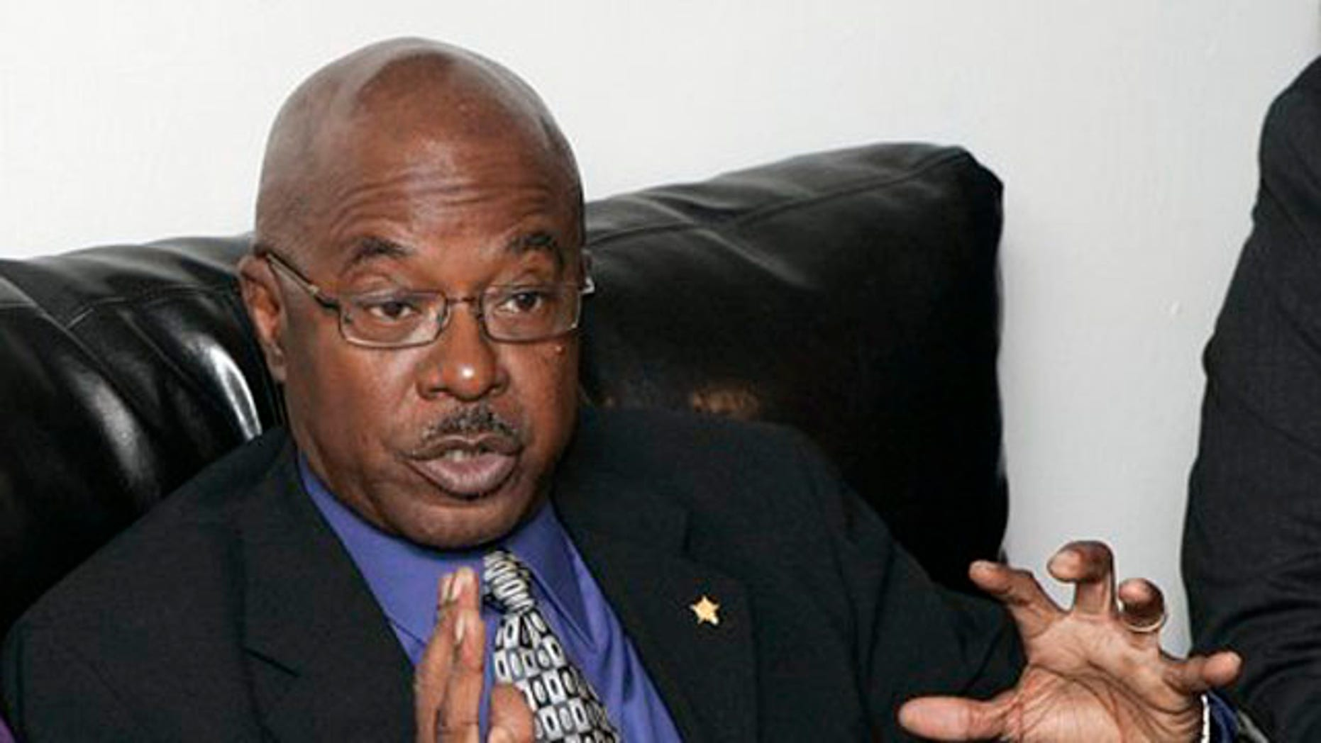 November 28, 2011: Julian White, former director of Florida A&M University's famed Marching 100 band, speaks at a news conference.