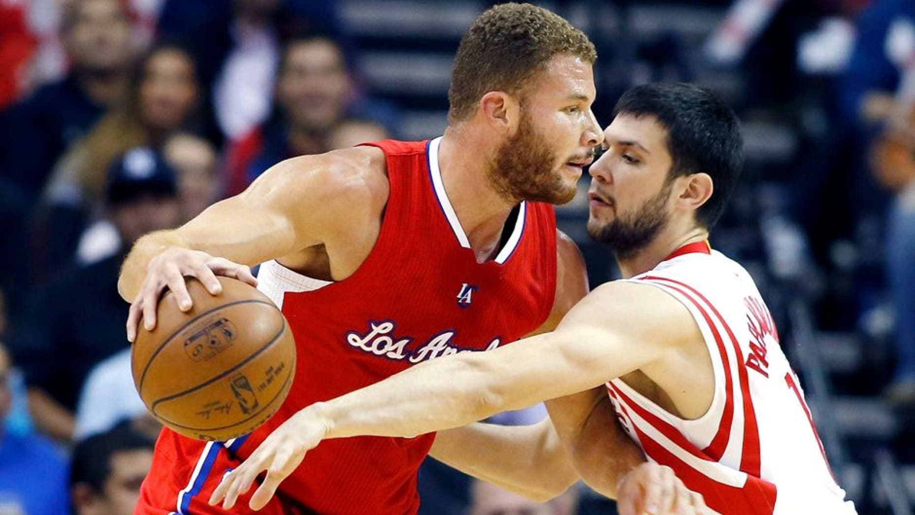 HOUSTON, TX - NOVEMBER 28: Blake Griffin #32 of the Los Angeles Clippers drives with the basketball against Kostas Papanikolaou #16 of the Houston Rockets during their game at the Toyota Center on November 28, 2014 in Houston, Texas. NOTE TO USER: User expressly acknowledges and agrees that, by downloading and/or using this photograph, user is consenting to the terms and conditions of the Getty Images License Agreement. (Photo by Scott Halleran/Getty Images)