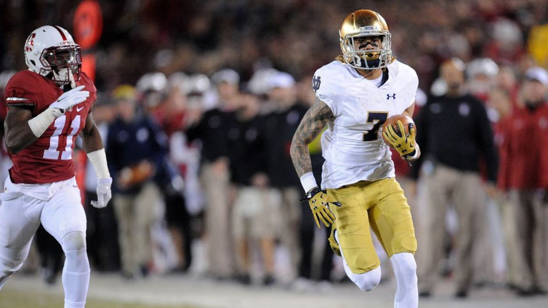 November 28, 2015; Stanford, CA, USA; Notre Dame Fighting Irish wide receiver Will Fuller catches a pass and runs for a touchdown ahead of Stanford Cardinal cornerback Terrence Alexander (11) during the first half at Stanford Stadium. Mandatory Credit: Gary A. Vasquez-USA TODAY Sports