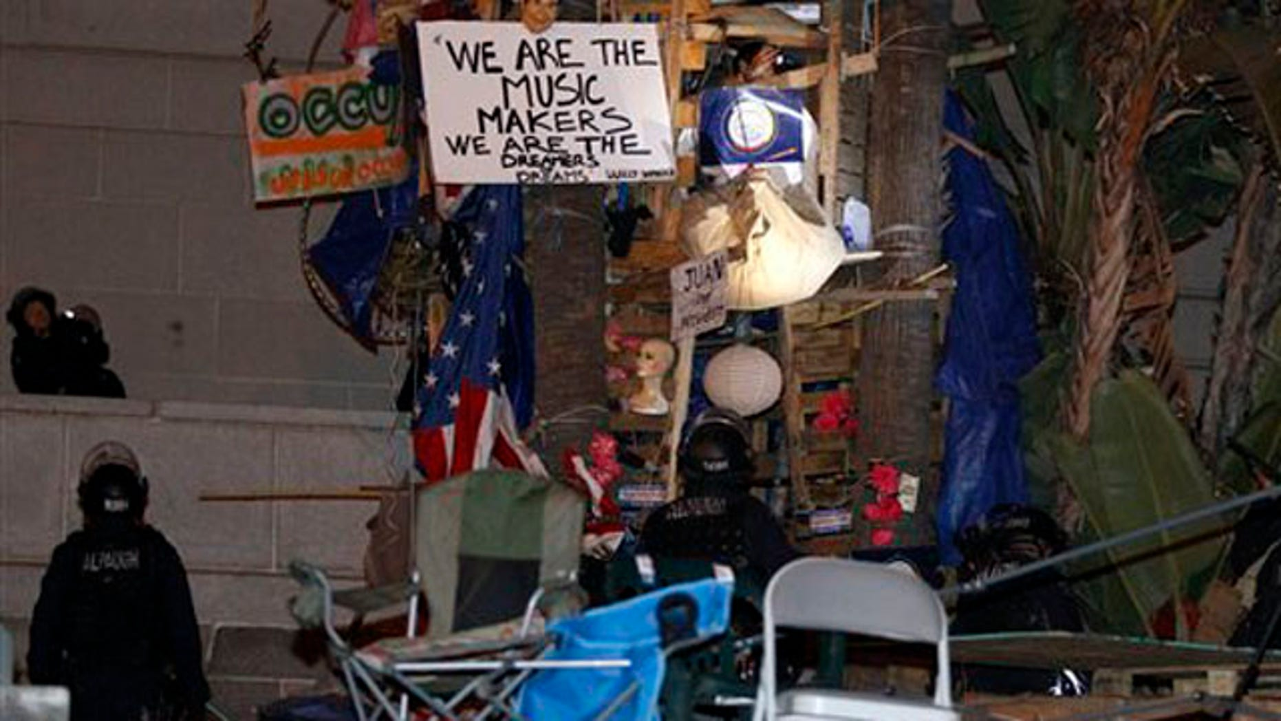 November 30, 2011: Police prepare to remove a structure at the Occupy Los Angeles encampment outside City Hall in Los Angeles .