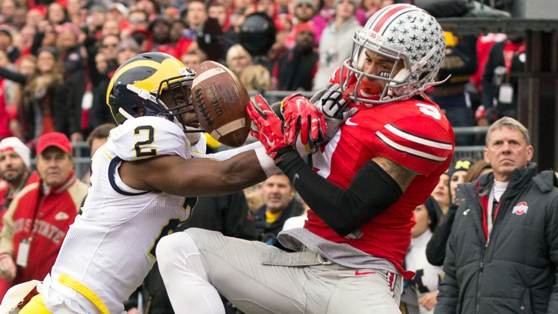 Nov 29, 2014; Columbus, OH, USA; Michigan Wolverines defensive back Blake Countess (2) breaks up a pass intended for Ohio State Buckeyes wide receiver Devin Smith (9) at Ohio Stadium. Mandatory Credit: Greg Bartram-USA TODAY Sports