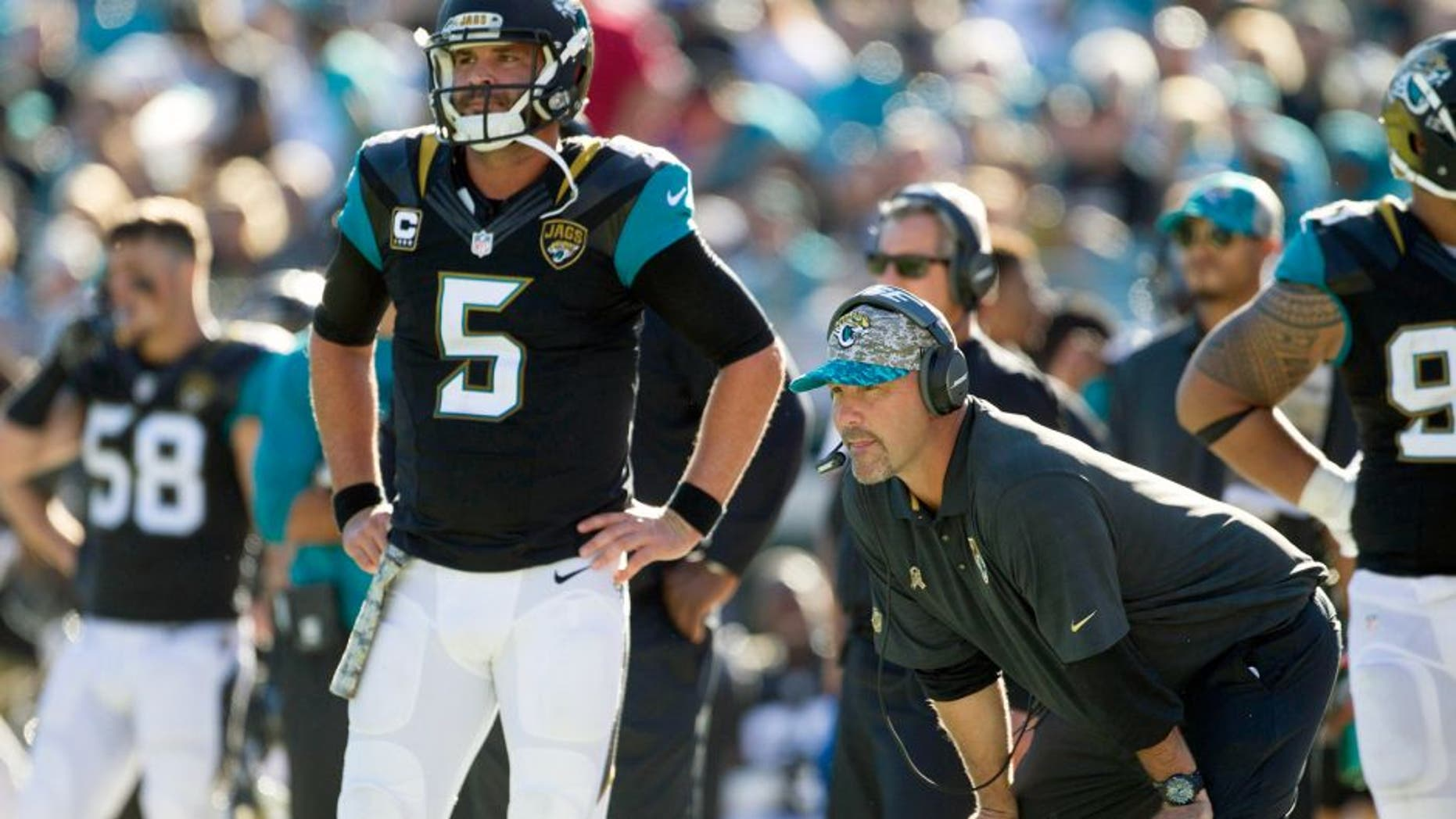 Nov 29, 2015; Jacksonville, FL, USA; Jacksonville Jaguars quarterback Blake Bortles (5) and head coach Gus Bradley look on during the third quarter against the San Diego Chargers at EverBank Field. The San Diego Chargers won 31-25. Mandatory Credit: Logan Bowles-USA TODAY Sports