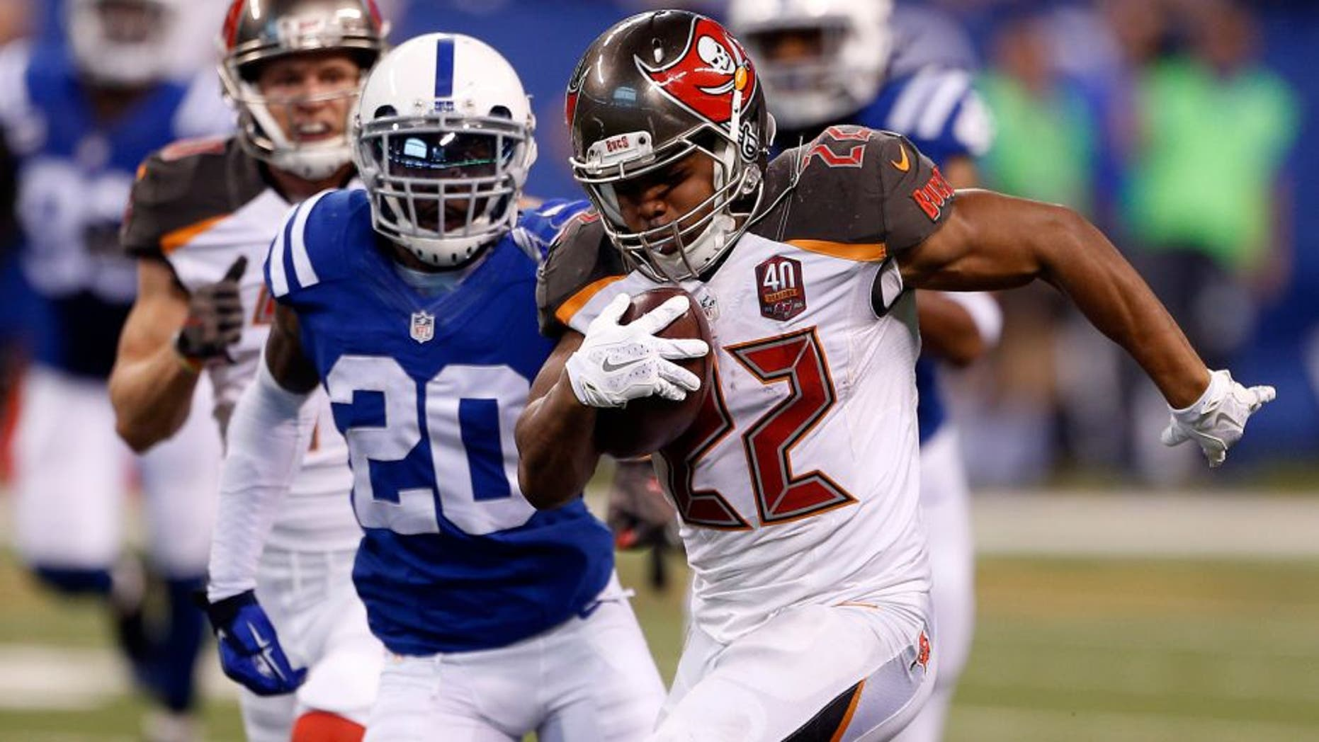 Nov 29, 2015; Indianapolis, IN, USA; Tampa Bay Buccaneers running back Doug Martin (22) is tackled by Indianapolis Colts cornerback Darius Butler (20) at Lucas Oil Stadium. Mandatory Credit: Brian Spurlock-USA TODAY Sports