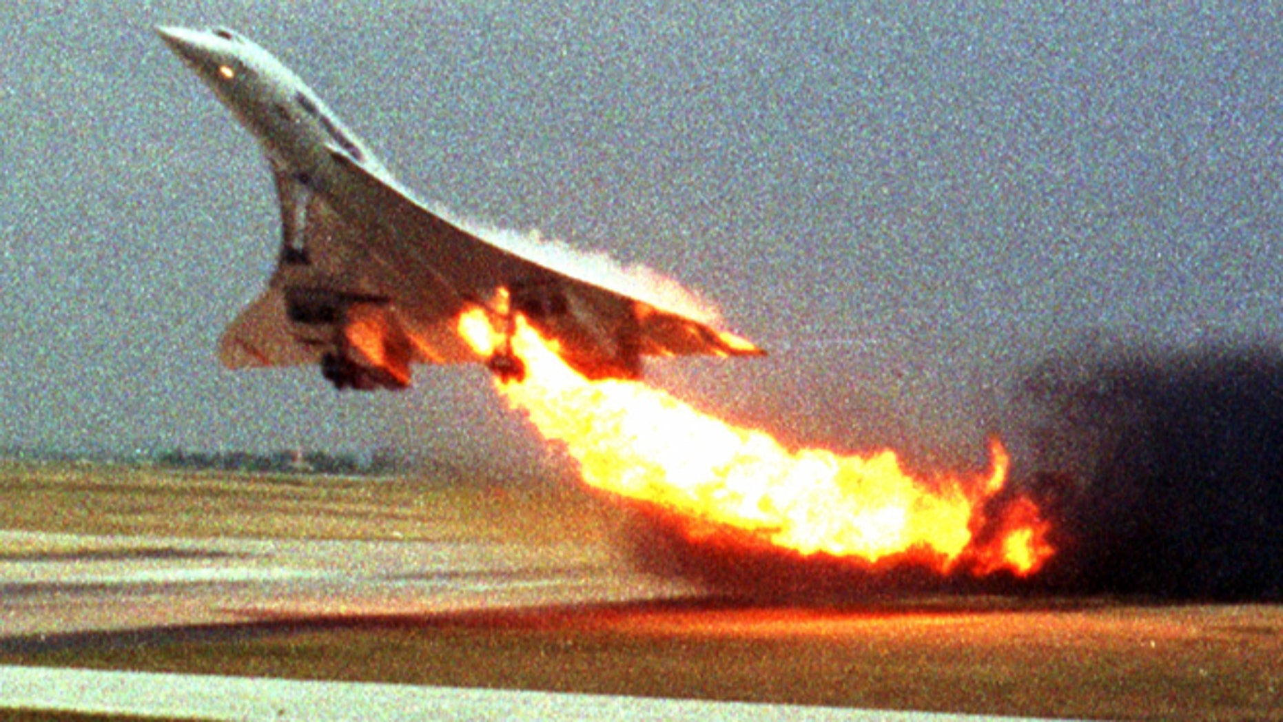 FILE - In this July 25, 2000, file photo, Air France Concorde flight 4590 takes off with fire trailing from its engine on the left wing from Charles de Gaulle airport in Paris.