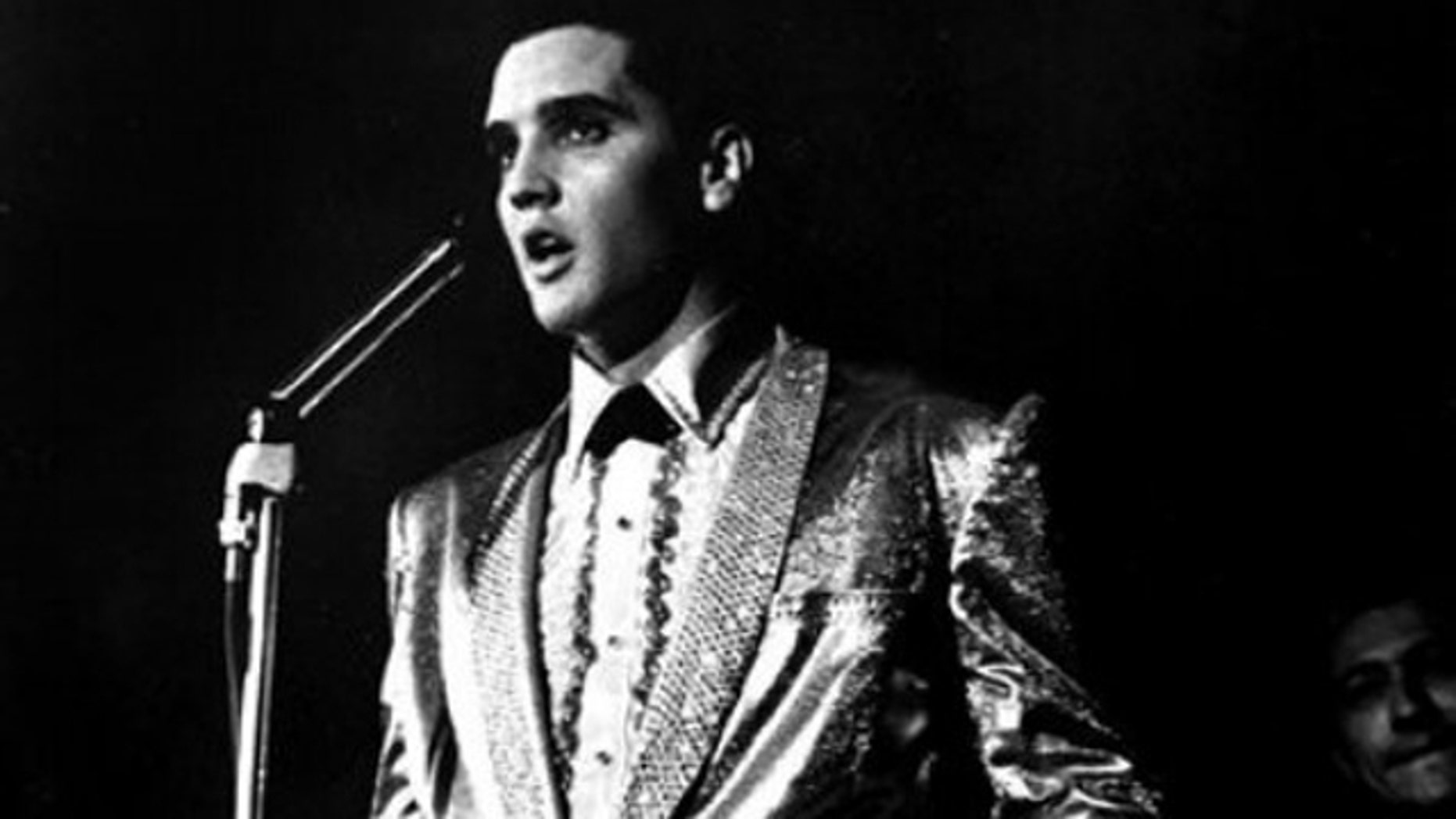 In this photo taken March 25, 1961 and provided by the World War II Valor in the Pacific National Monument, Elvis Presley performs at the Bloch Arena on the Pearl Harbor Navel base in Honolulu, Hawaii. Fifty years ago, Elvis Presley helped raise money and bring attention to help build the USS Arizona Memorial. The King is being asked to deliver one more time.  (AP Photo/ Word War II Valor in the Pacific National Monument)