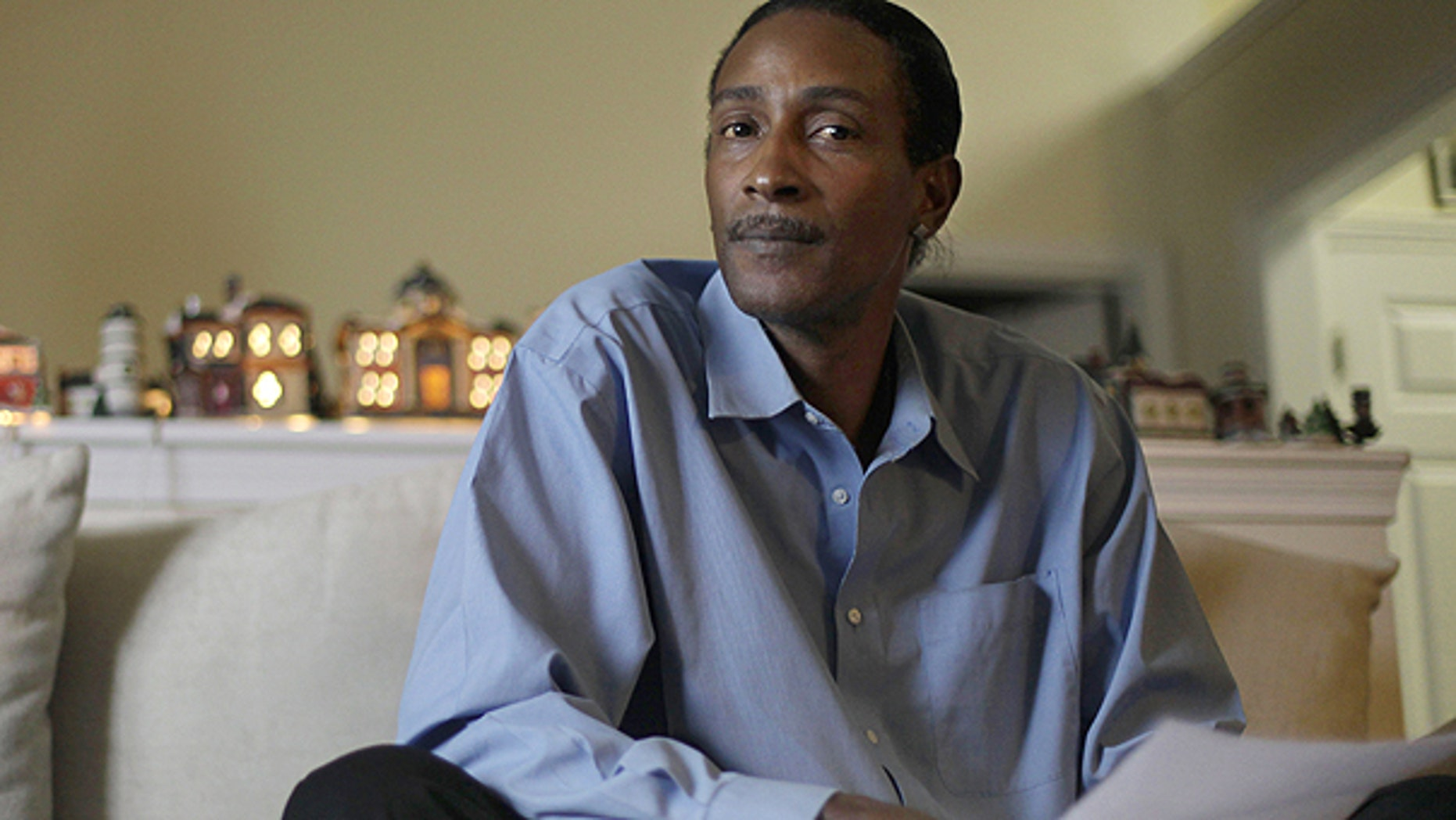 Nov. 30: Wayne Pittman, 46, sits in his Lawrenceville, Ga., home looking over unemployment papers as his extended benefits are set to expire unless Congress passes a vote to extend them.