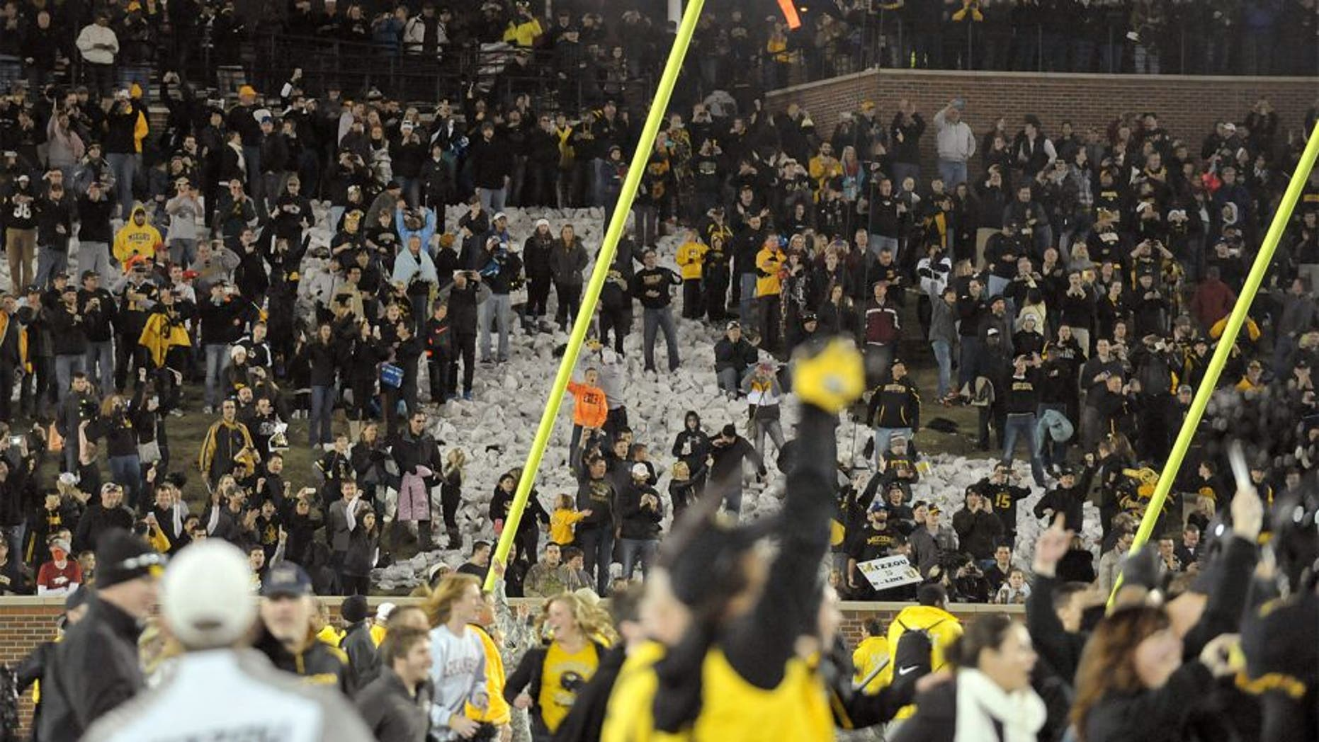 Nov 28, 2014; Columbia, MO, USA; Missouri Tigers fans and students storm the field and tear down the goalposts after the game against the Arkansas Razorbacks at Faurot Field. Missouri won 21-14. Mandatory Credit: Denny Medley-USA TODAY Sports