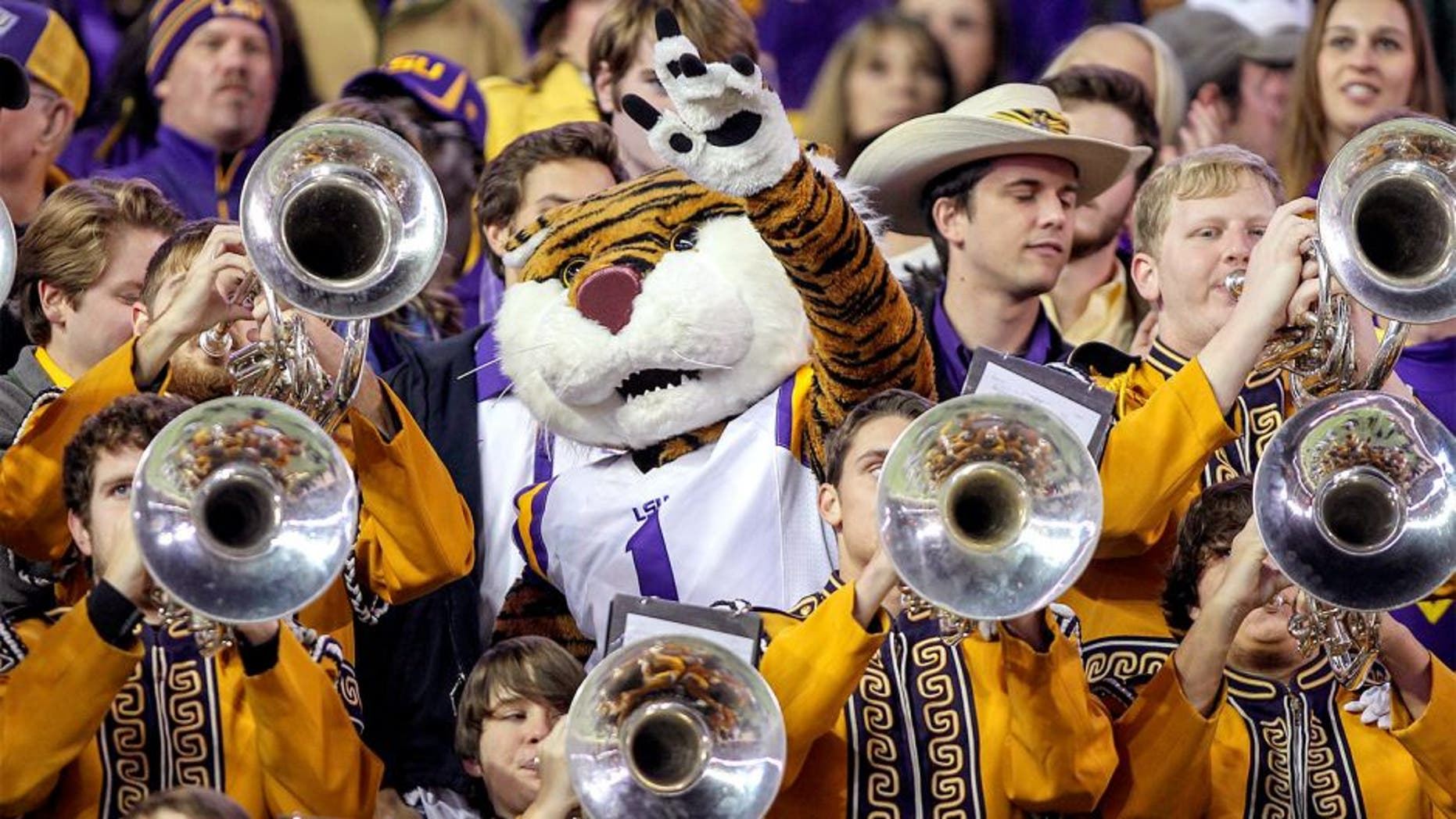 Nov 27, 2014; College Station, TX, USA; LSU Tigers mascot Mike the Tiger and the band perform during the game against the Texas A&M Aggies at Kyle Field. Mandatory Credit: Troy Taormina-USA TODAY Sports