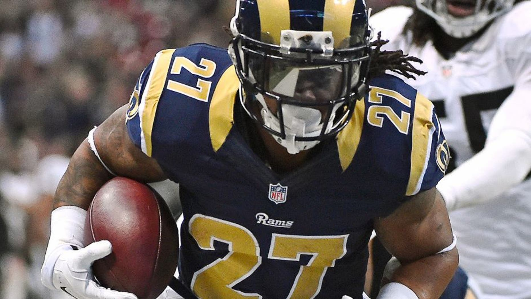 Nov 30, 2014; St. Louis, MO, USA; St. Louis Rams running back Tre Mason (27) runs in for a touchdown against the Oakland Raiders during the first half at the Edward Jones Dome. Mandatory Credit: Jasen Vinlove-USA TODAY Sports