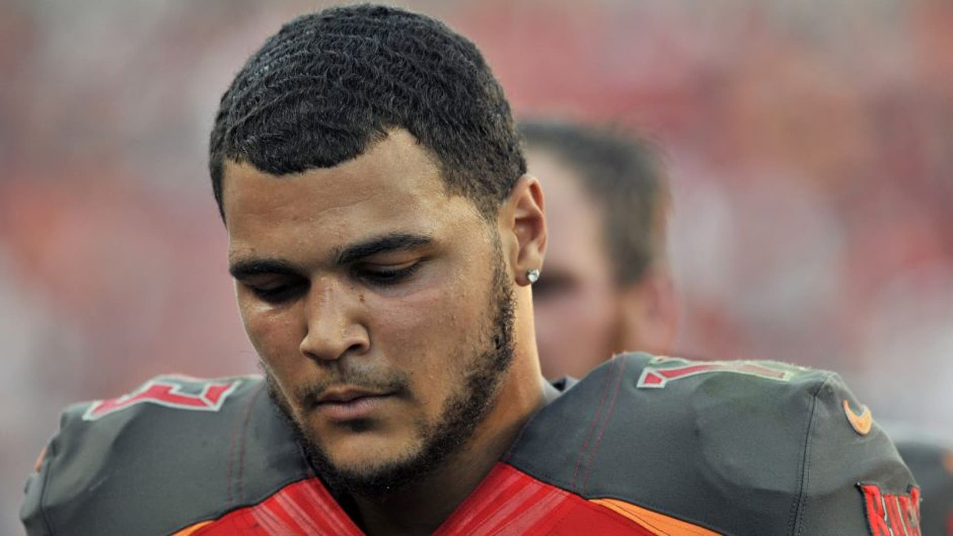 Tampa Bay Buccaneers wide receiver Mike Evans (13) leaves the field following the team's 14-13 loss to the Cincinnati Bengals during an NFL football game Sunday, Nov. 30, 2014, in Tampa, Fla. (AP Photo/Steve Nesius)