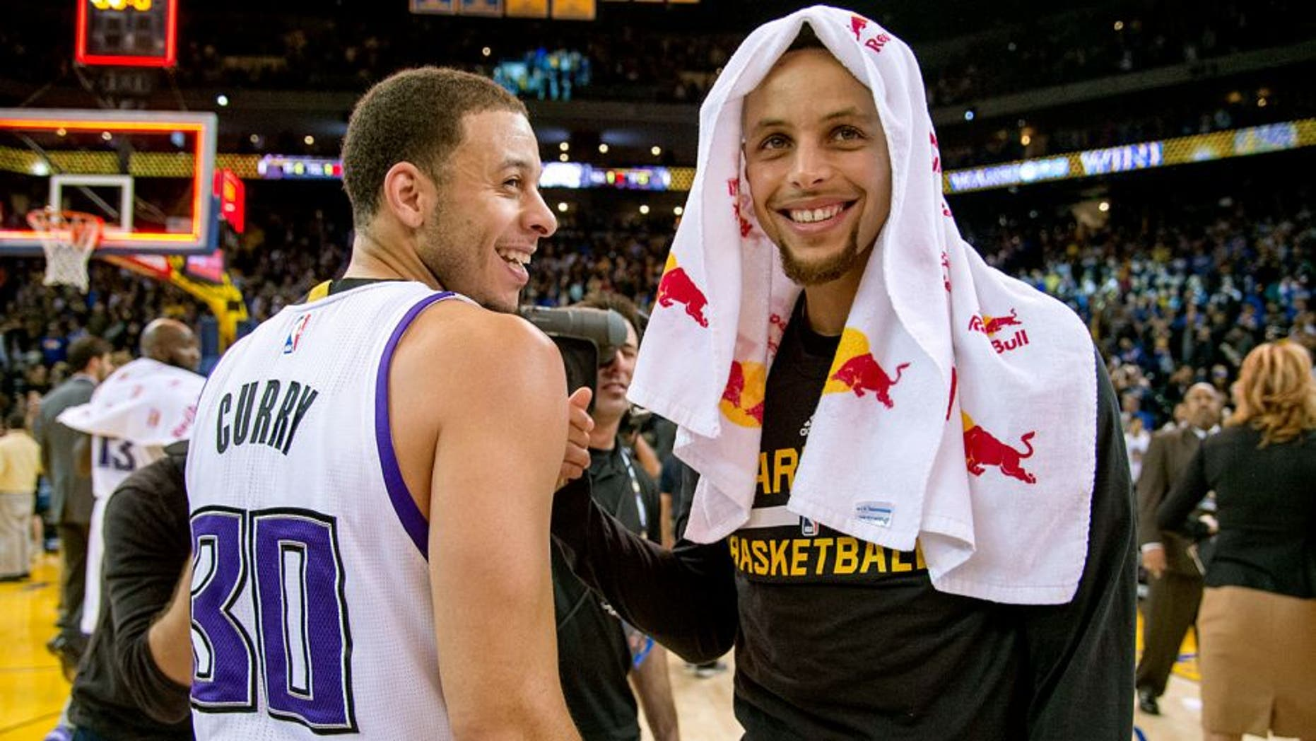 November 28, 2015; Oakland, CA, USA; Sacramento Kings guard Seth Curry (30, left) smiles while talking with Golden State Warriors guard Stephen Curry (30, right) after the game at Oracle Arena. The Warriors defeated the Kings 120-101. Mandatory Credit: Kyle Terada-USA TODAY Sports