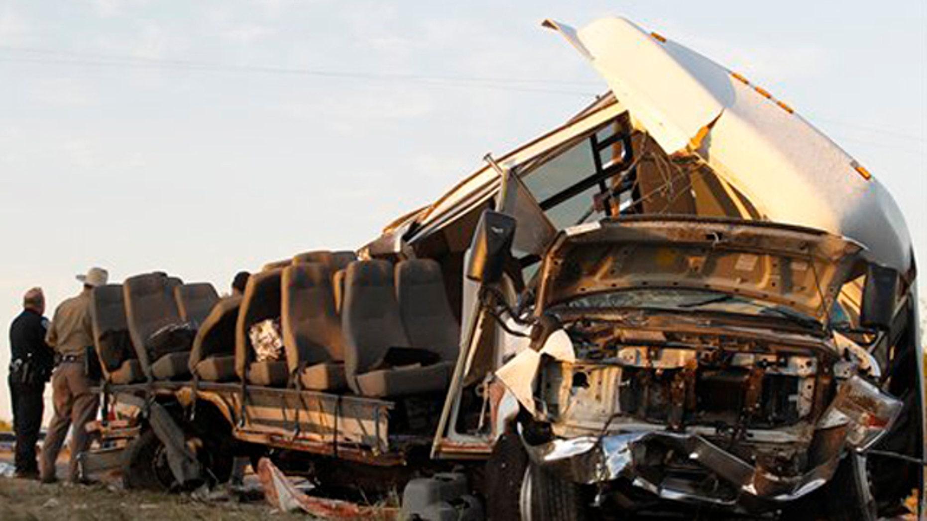 November 4, 2011: Investigators examine a bus after the crash Paint Rock, Texas.