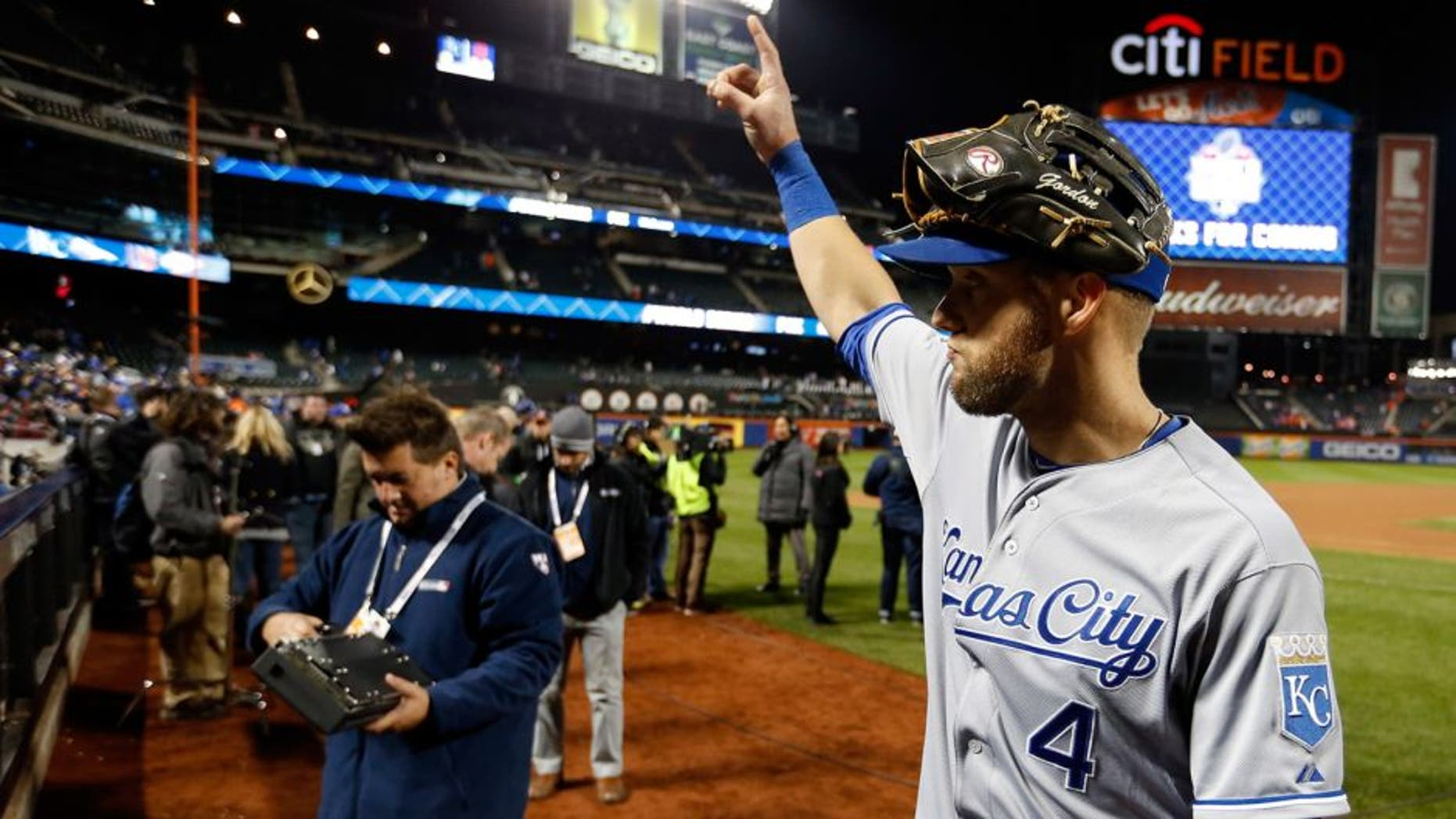 NEW YORK, NY - OCTOBER 31: Alex Gordon #4 of the Kansas City Royals celebrates after defeating the New York Mets by a score of 5-3 to win Game Four of the 2015 World Series at Citi Field on October 31, 2015 in the Flushing neighborhood of the Queens borough of New York City. (Photo by Sean M. Haffey/Getty Images)