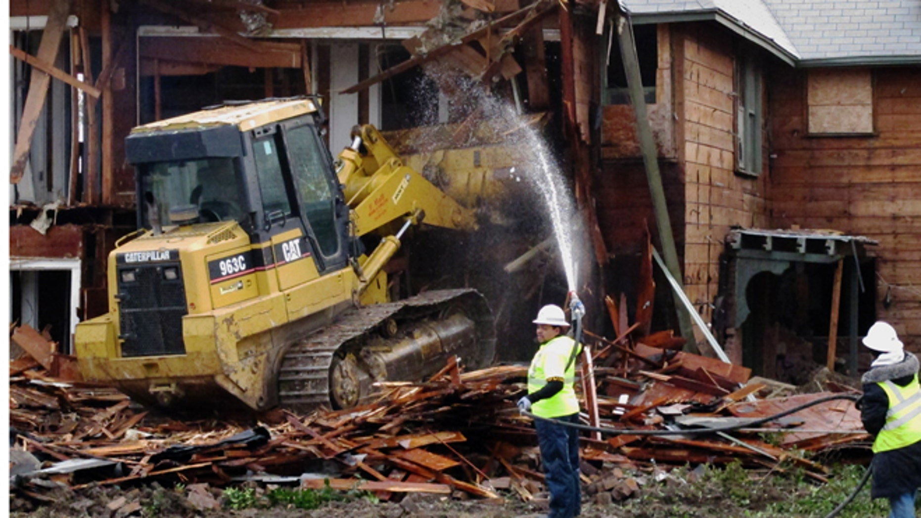 Jan. 14, 2013: A bulldozer is used to demolish a two-story apartment building  in Dallas, Texas where Lee Harvey Oswald briefly lived before assassinating President John F. Kennedy.