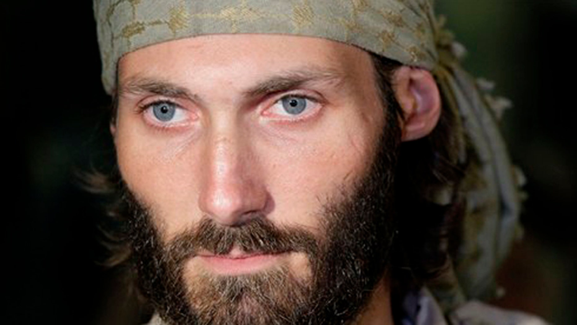 November 5, 2011: Matthew VanDyke, who spent months in Libyan prisons before joining rebel forces who opposed dictator Muammar Qaddafi, speaks with reporters after his flight arrived at Baltimore-Washington International Airport in Linthicum, Md.