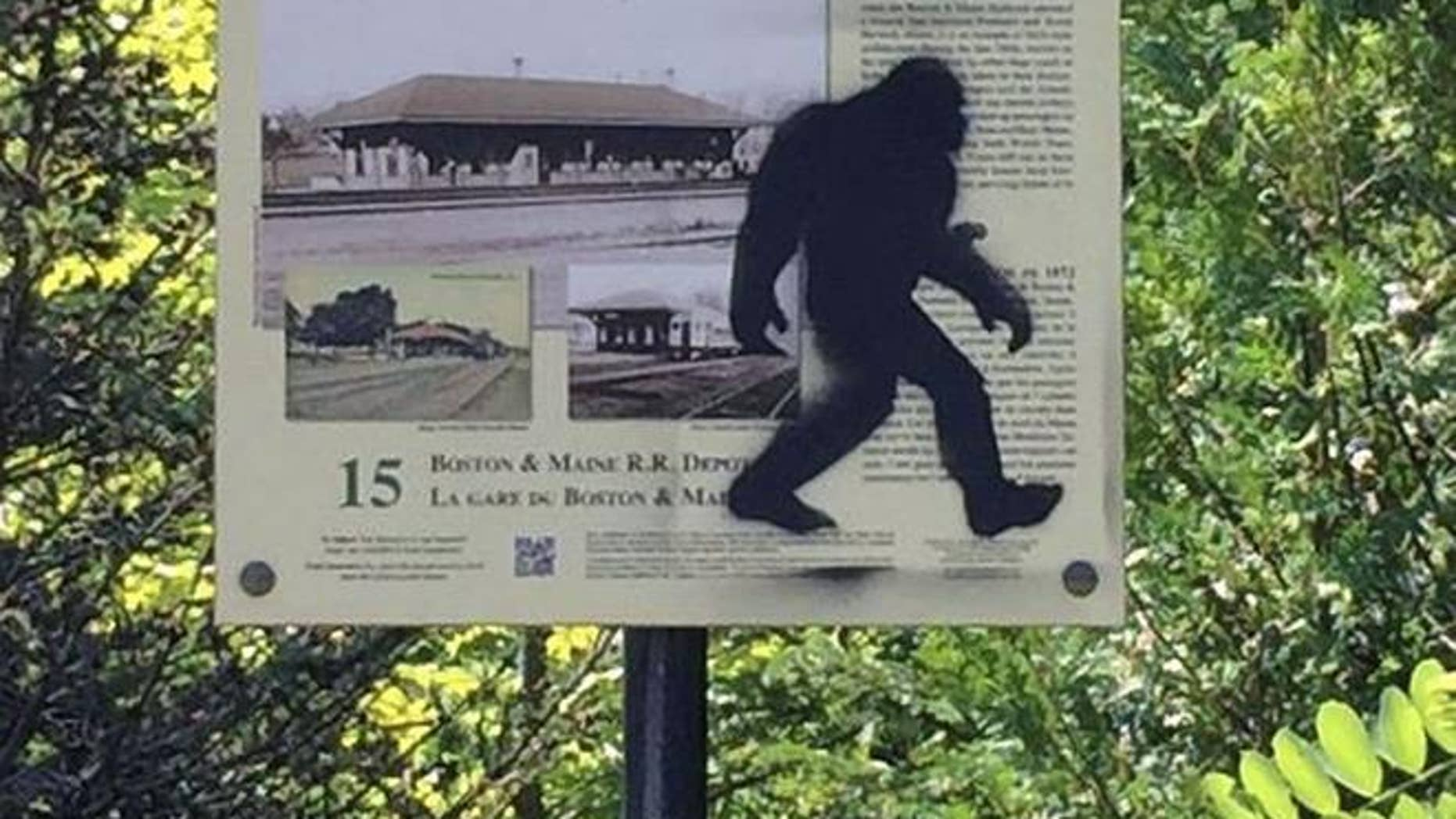 This photo provided by the Kennebunk Police Department shows graffiti on a sign in Kennebunk, Maine. A prankster spray-painted Bigfoot on town signs.