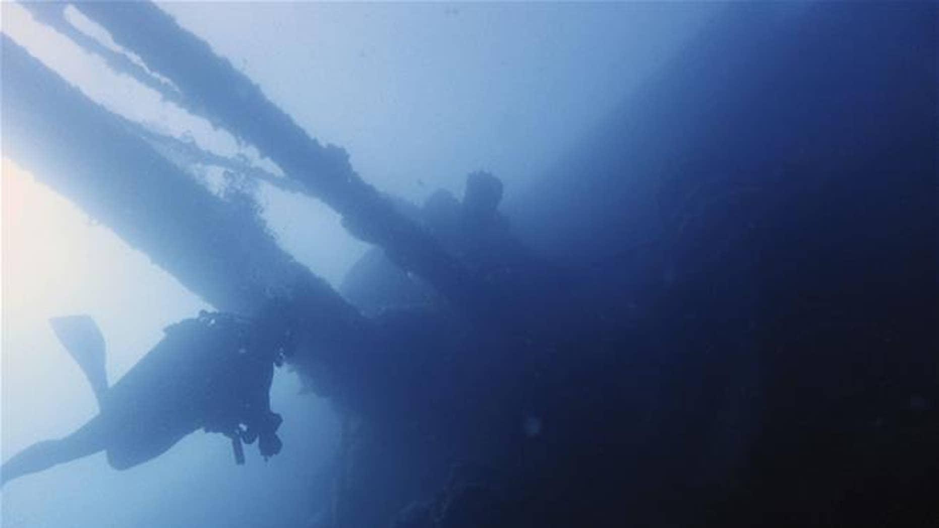 A diver swims under part of the Italian World War II shipwreck MV Probitas in a bay near Saranda, Albania.