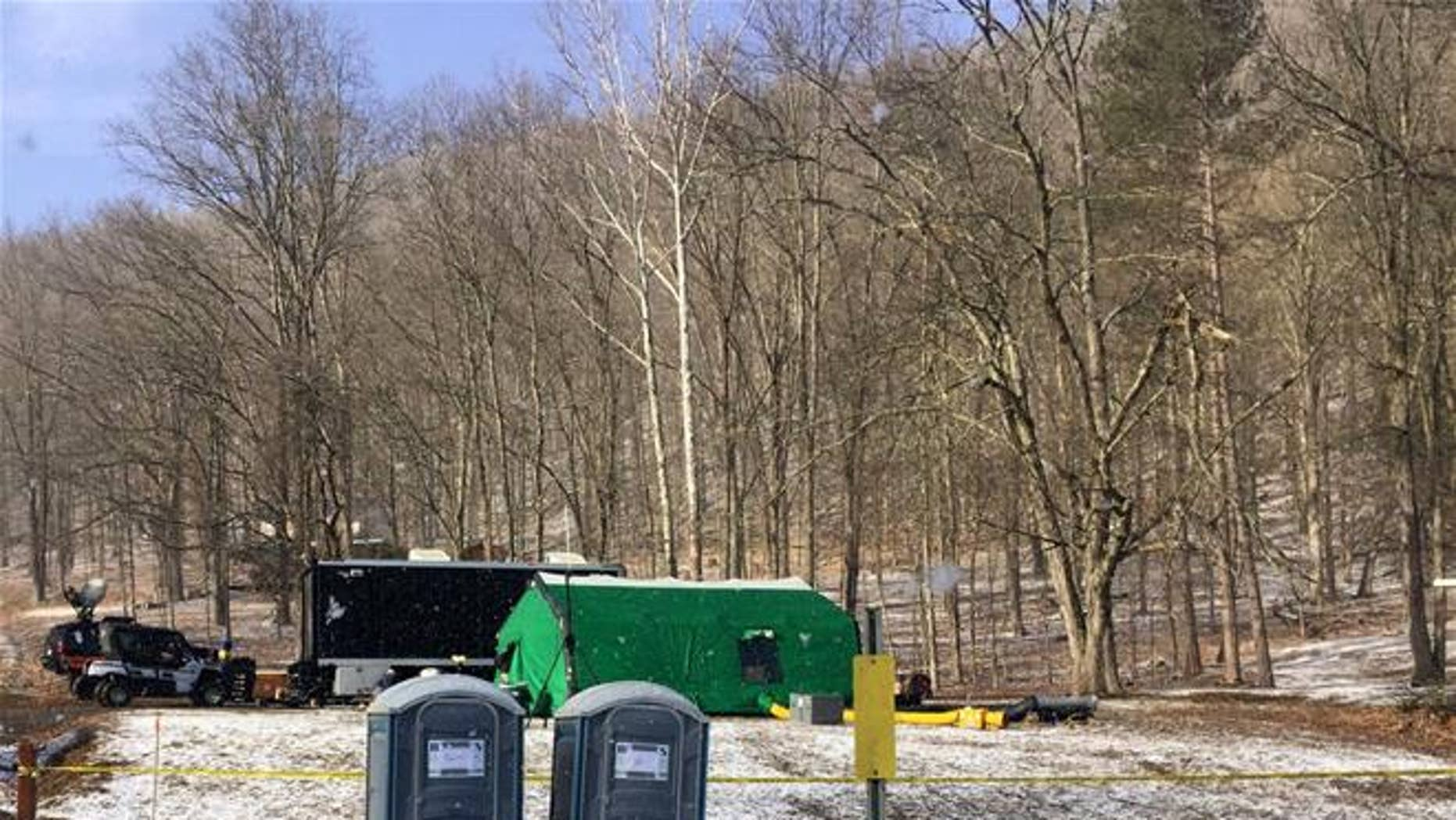 FBI agents and representatives of the Pennsylvania Department of Conservation and Natural Resources set up a base off Route 555 in Benezette Township, Elk County, Pa., at a site where treasure hunters say Civil War-era gold is buried.