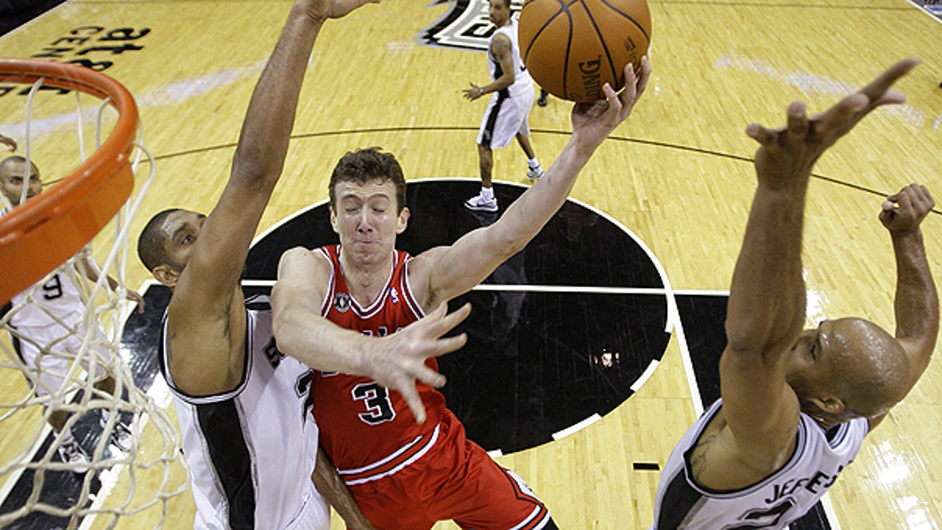 Nov. 17: Chicago Bulls' Omer Asik (3), of Turkey, goes to the basket between San Antonio Spurs' Tim Duncan, left, and Richard Jefferson during the second quarter of an NBA basketball game in San Antonio.