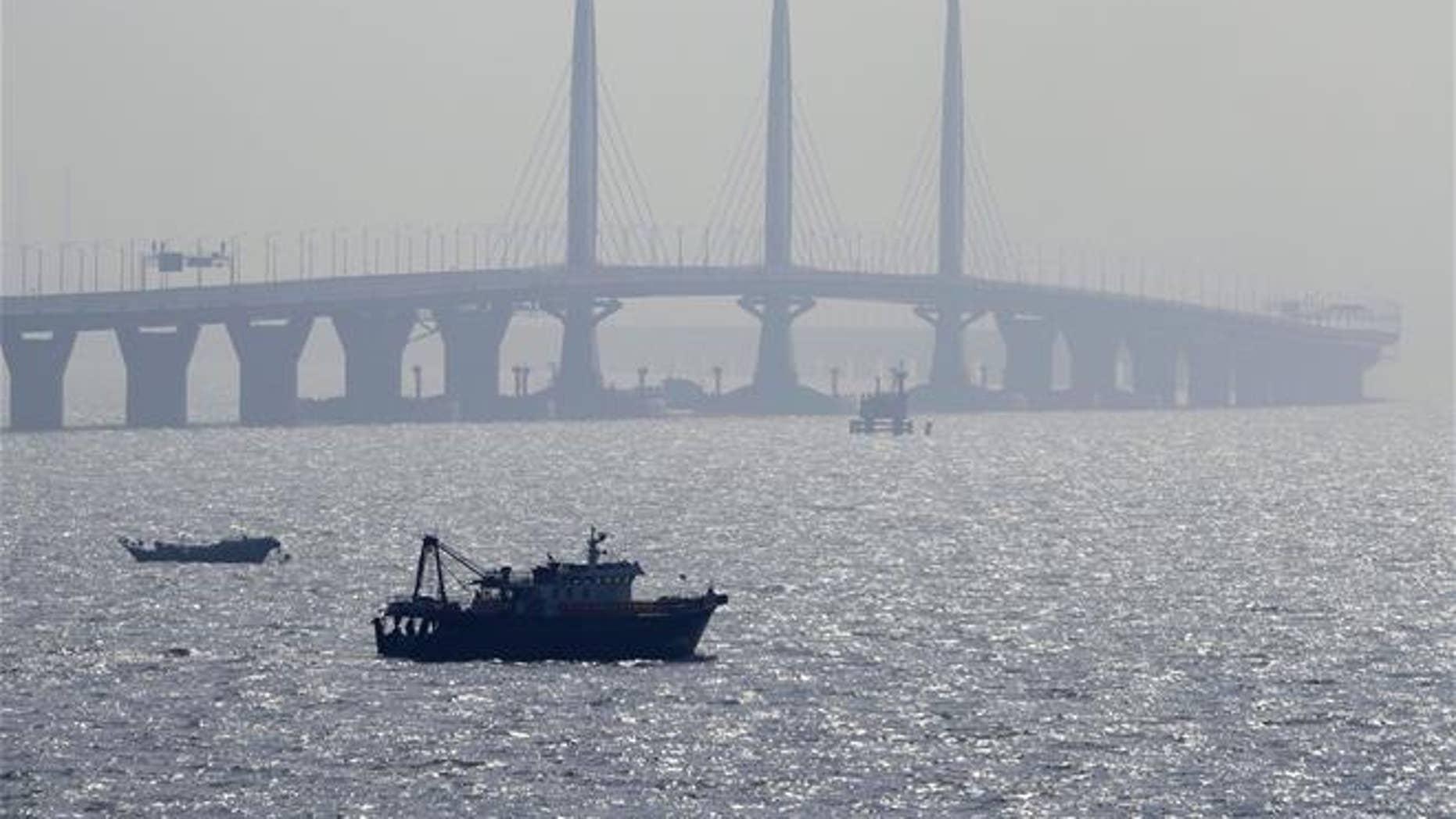 A boat sails near the Hong Kong-Zhuhai-Macau Bridge, in Zhuhai city in China on March 28, 2018.
